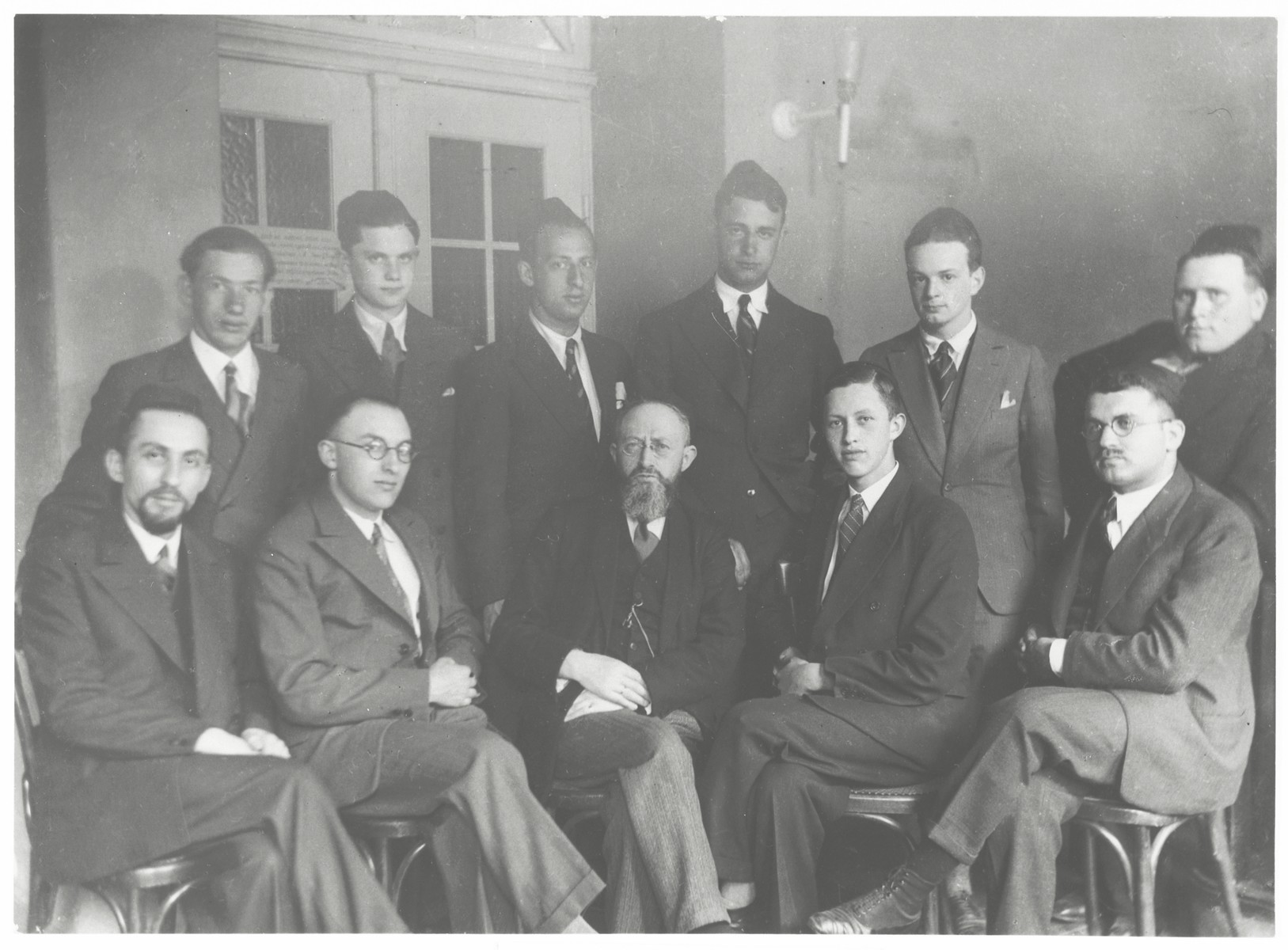 Members of the Jewish Council in Kiel.  Rabbi Baruch Posner is in the front center.
