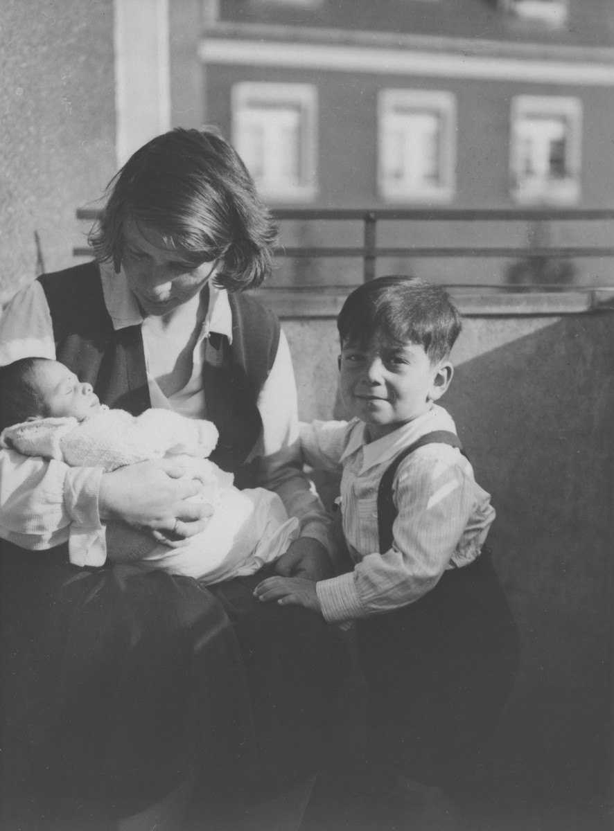 Friederike Oppenheimer cradles her newborn son, Rudi, while his older brother Paul looks on.
