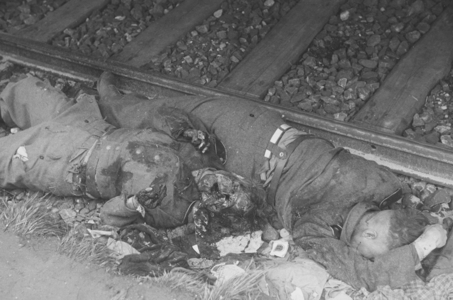 Camp guards, killed in revenge killings, lie next to the railroad tracks in the Dachau concentration camp.