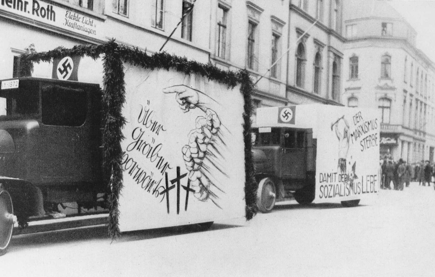 Nazi Party propaganda trucks in the streets of Berlin during a Reichstag election.