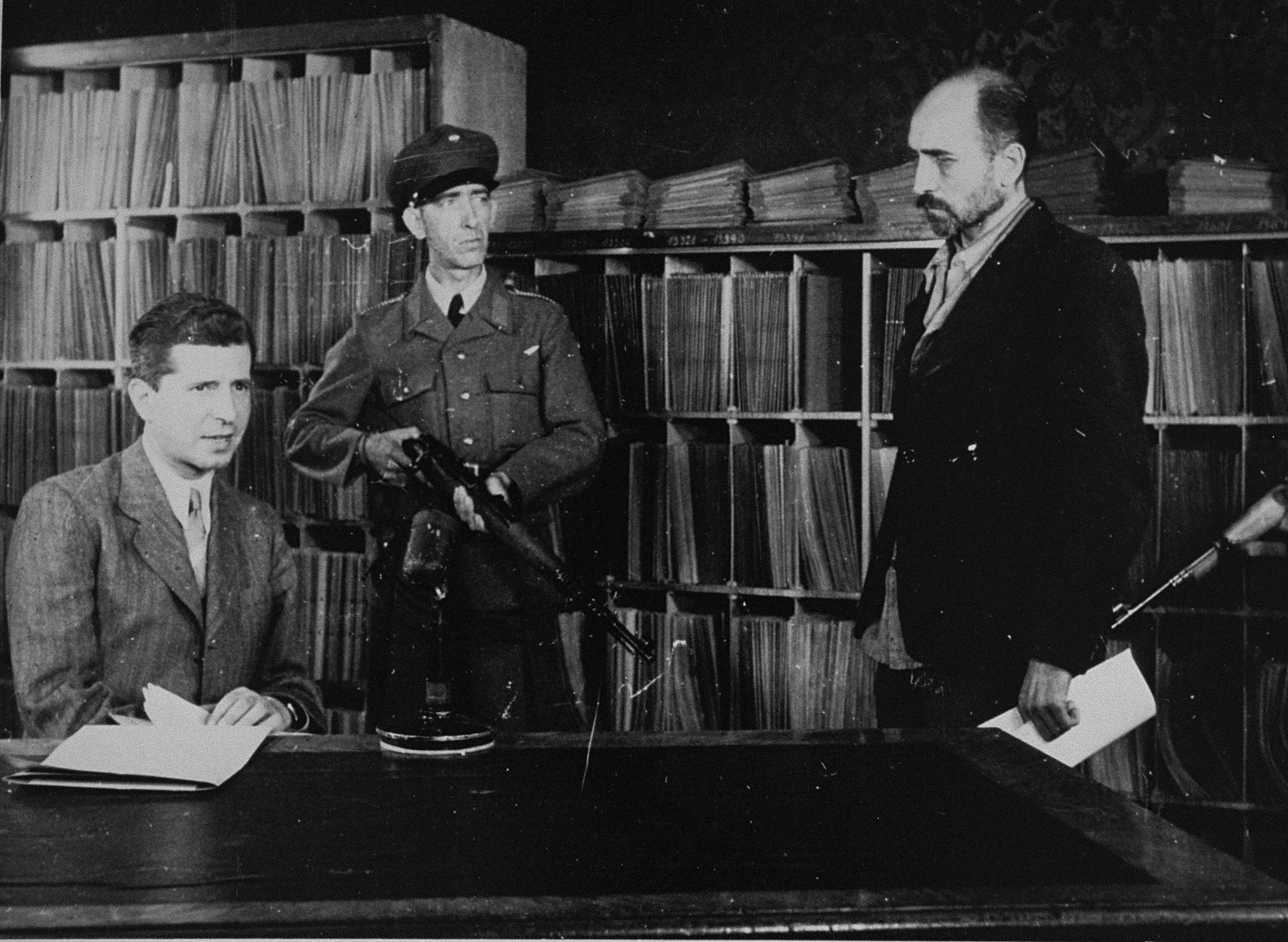 Former SS Second Lieutenant Maximillian Grabner (left) is interrogated by Heinrich Duermayer, the chief of the Austrian Political Police [Staatspolizei].
