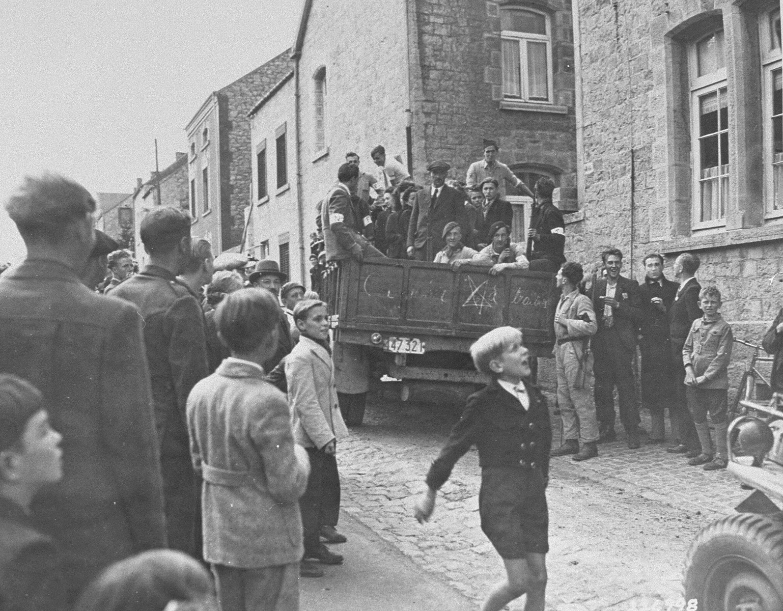 "Members of the Belgian resistance (the ""FIN"") arrest alleged collaborators in Couvin following the liberation of the town by Allied forces."