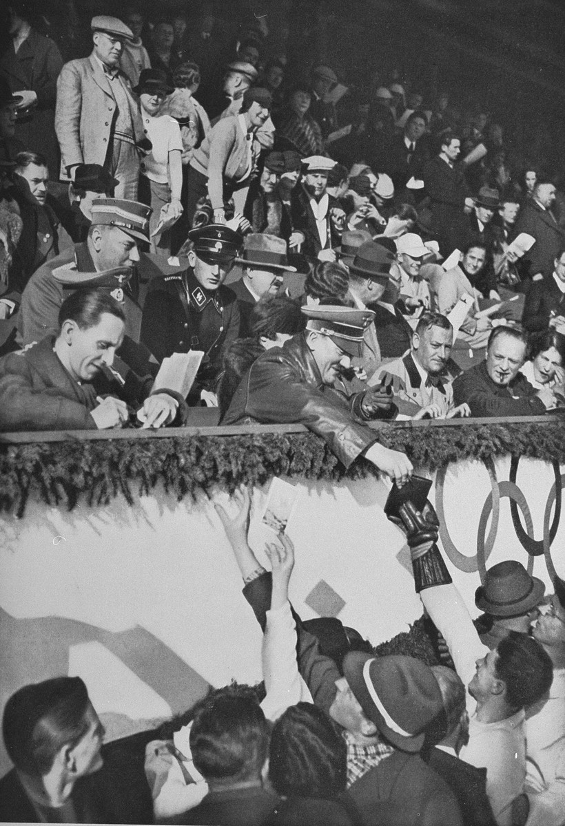Adolf Hitler and Josef Goebbels sign autographs for members of the Canadian figure skating team at the 1936 Olympics.