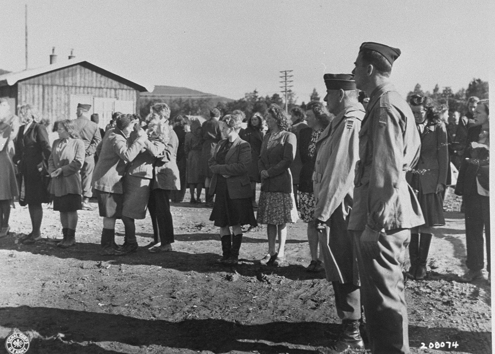 Brigadier General Owen Summers and Colonel Walker look on as Norwegian women suspected of collaborating with the Germans are screened by Allied authorities.