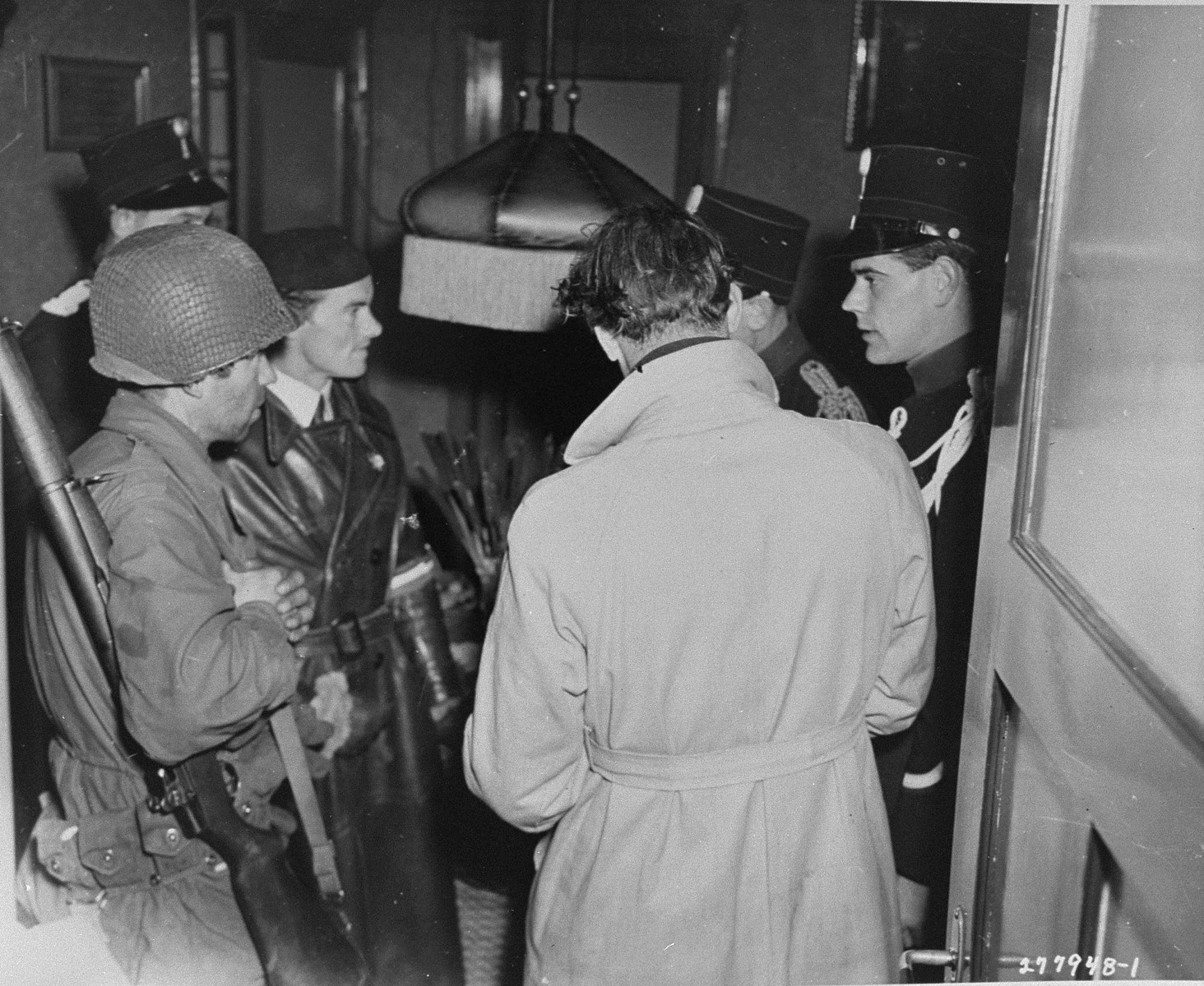 Members of the Dutch resistance, the Dutch police, and an American soldier search for uniforms and weapons belonging to Dutchmen suspected of collaborating with the Germans during the occupation.