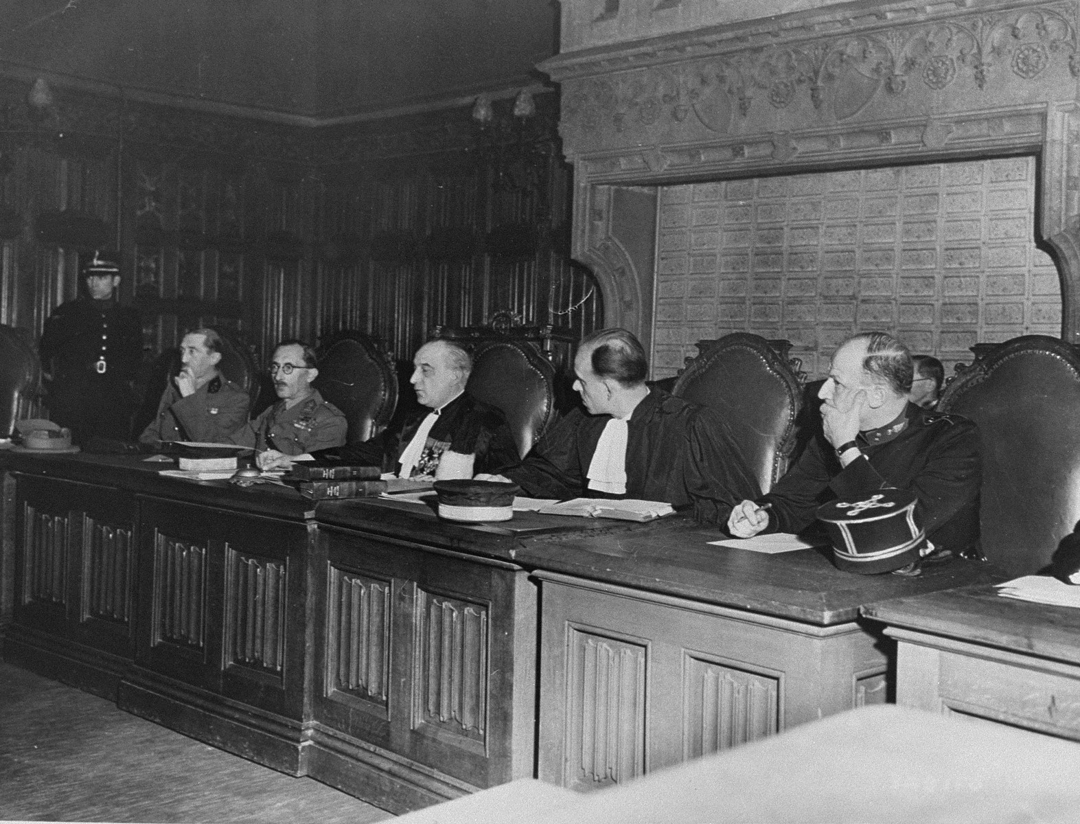 The members of a Belgian court hear the charges against five women accused of collaborating with the Germans during the occupation.