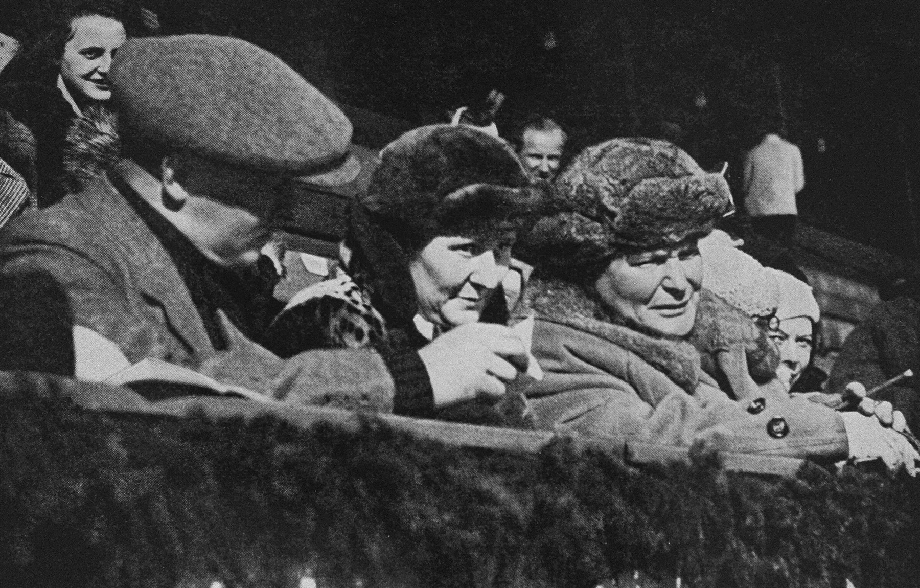 Hermann Goering watches an ice hockey game at the Winter Olympics.