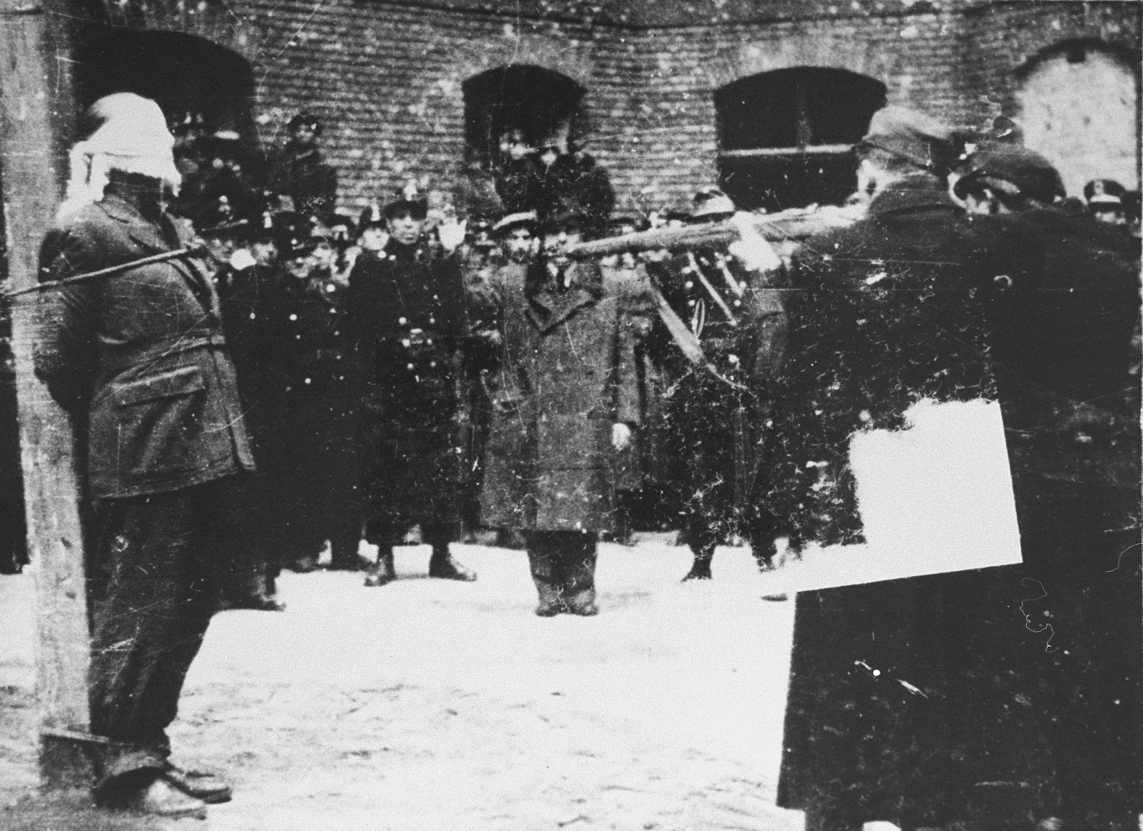 "Hungarian soldiers prepare to execute Ferenc Rajniss, the former Minister of Religious Affairs and Education in the Szalasi government, and editor of the right-wing, anti-Semitic journal ""Magyar Futar.""  Following his activities as the editor of the right-wing, anti-Semitic journal, ""Magyar Futar,"" Ferenc Rajniss served as the Minister for Religious Affairs and Education in the collaborationist government of Ferenc Szalasi.  His was the third postwar war crimes case to be tried by the People's Tribunal in the Budapest Academy of Music.  Proceedings began on November 28, 1945 and ended with Rajniss' conviction on December 7, 1945.  Rajniss was executed on March 12, 1946."