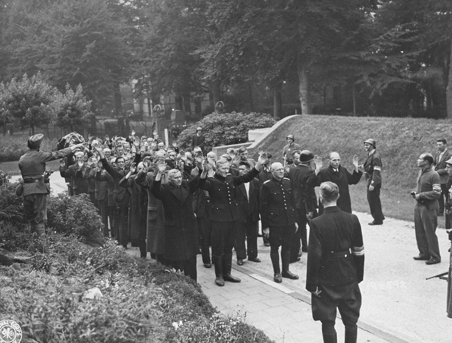 Dutch soldiers and members of the resistance arrest suspected civilian collaborators and former members of the Dutch Nazi Party.
