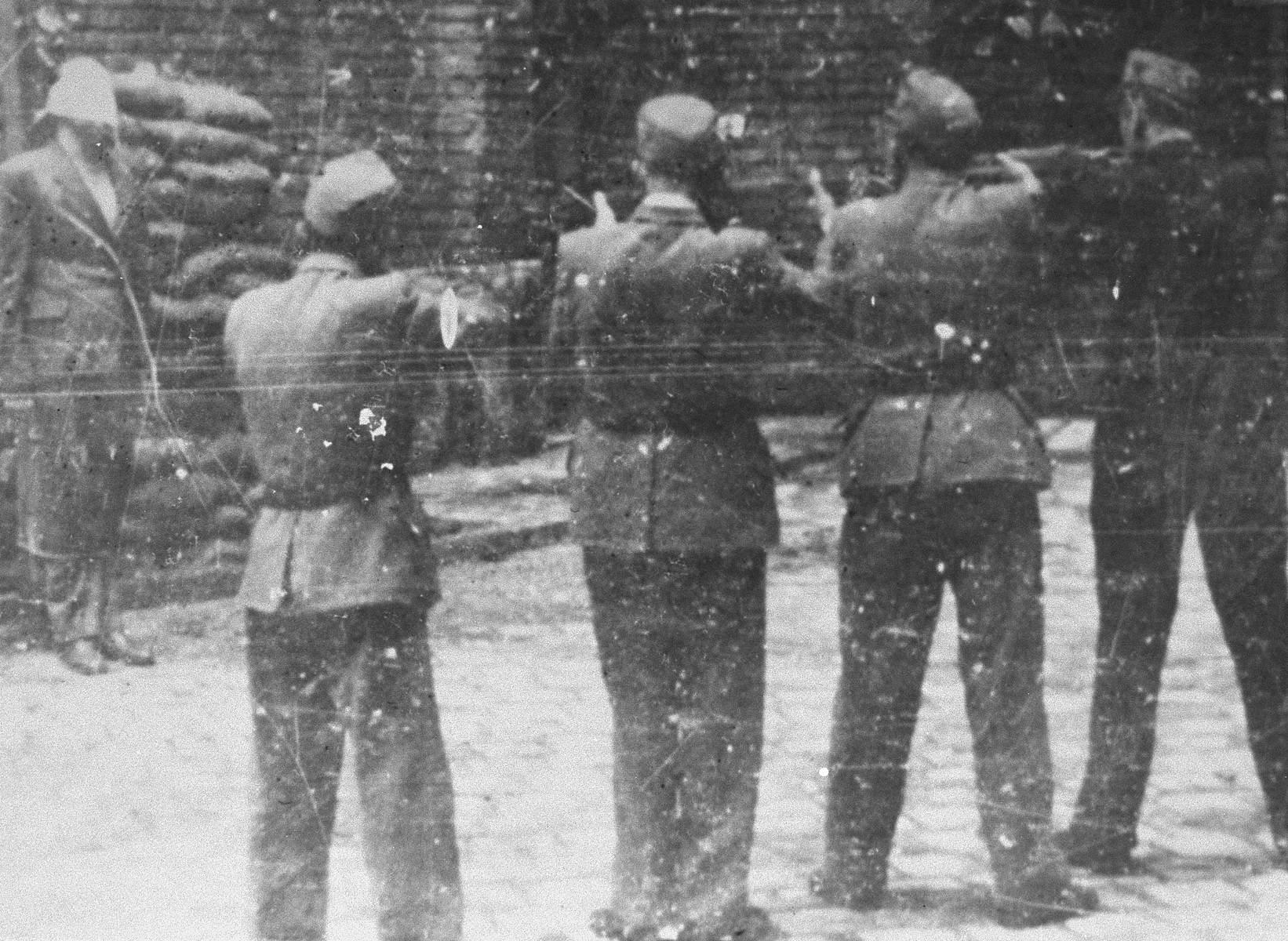 Hungarian troops prepare to execute Lajos Remenyi-Schneller.  Remenyi-Schneller was tried along with Dome Sztojay, Antal Kunder, Jeno Ratz, and Lajos Szasz by a People's Tribunal in the Budapest Academy of Music for his role in both the destruction of Hungarian Jewry and for sacrificing his country's interests by collaborating with the Third Reich.  The trial began on March 14, 1946 and ended only 8 days later on March 22, 1946 when all of the defendants were convicted, and subsequently executed.