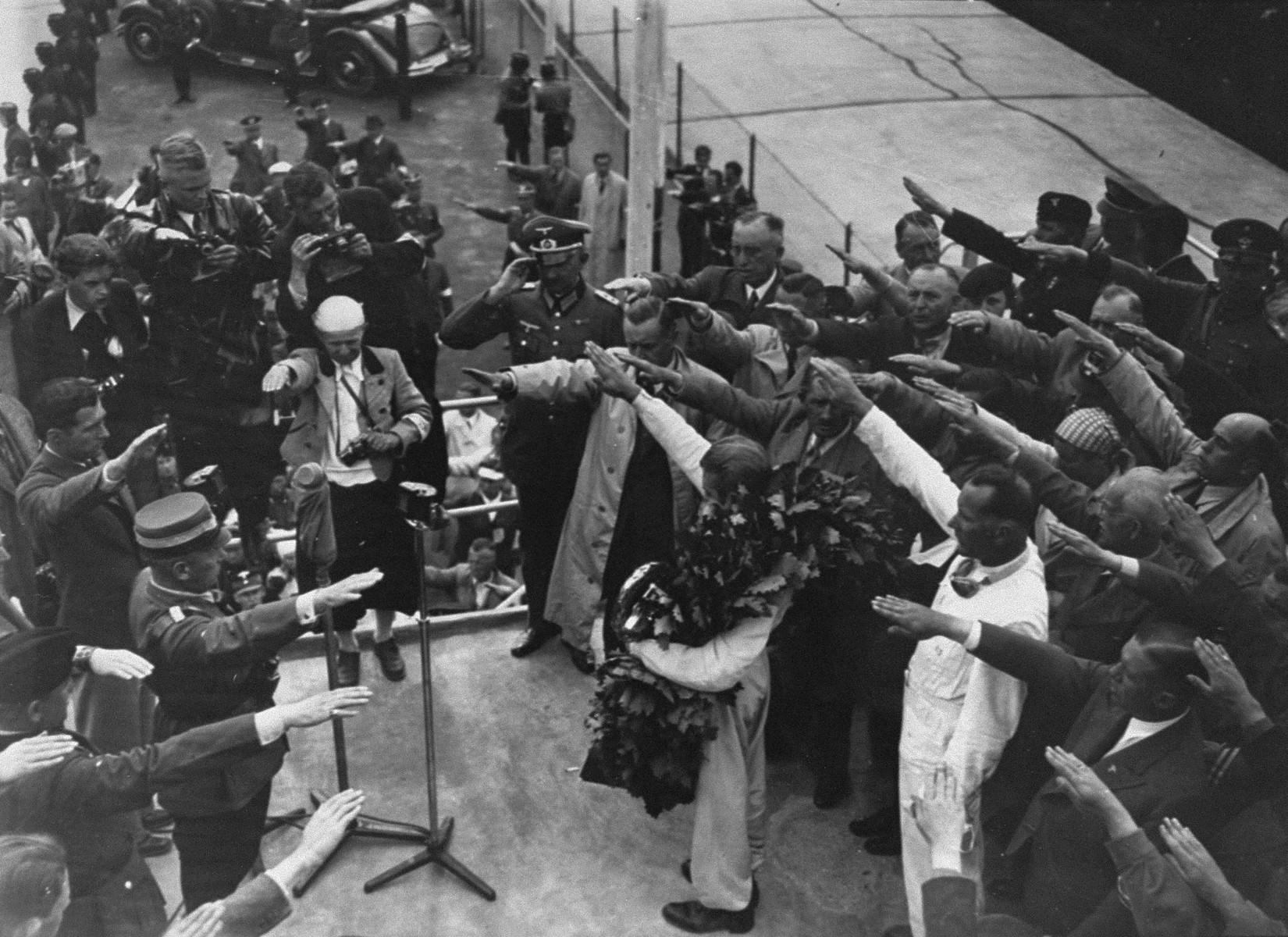 Reich Sport Leader Hans von Tschammer und Osten makes an announcement during the Berlin Olympic Games.
