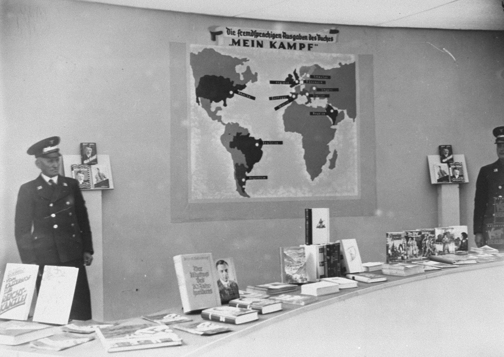 "An exhibit of Nazi publications touting the achievements of the Third Reich; including a poster showing countries in which ""Mein Kampf"" had been translated into the native language."