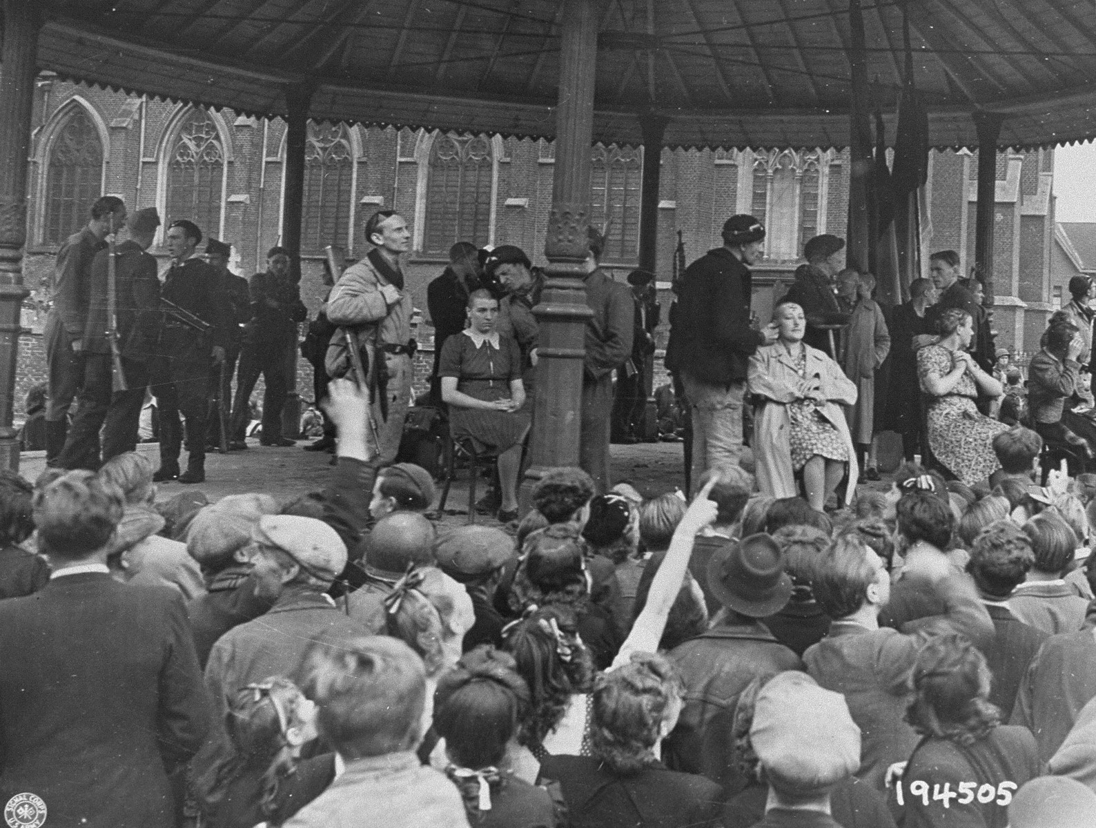 Members of the Belgian resistance shave the heads of women who collaborated with the Germans during the occupation.