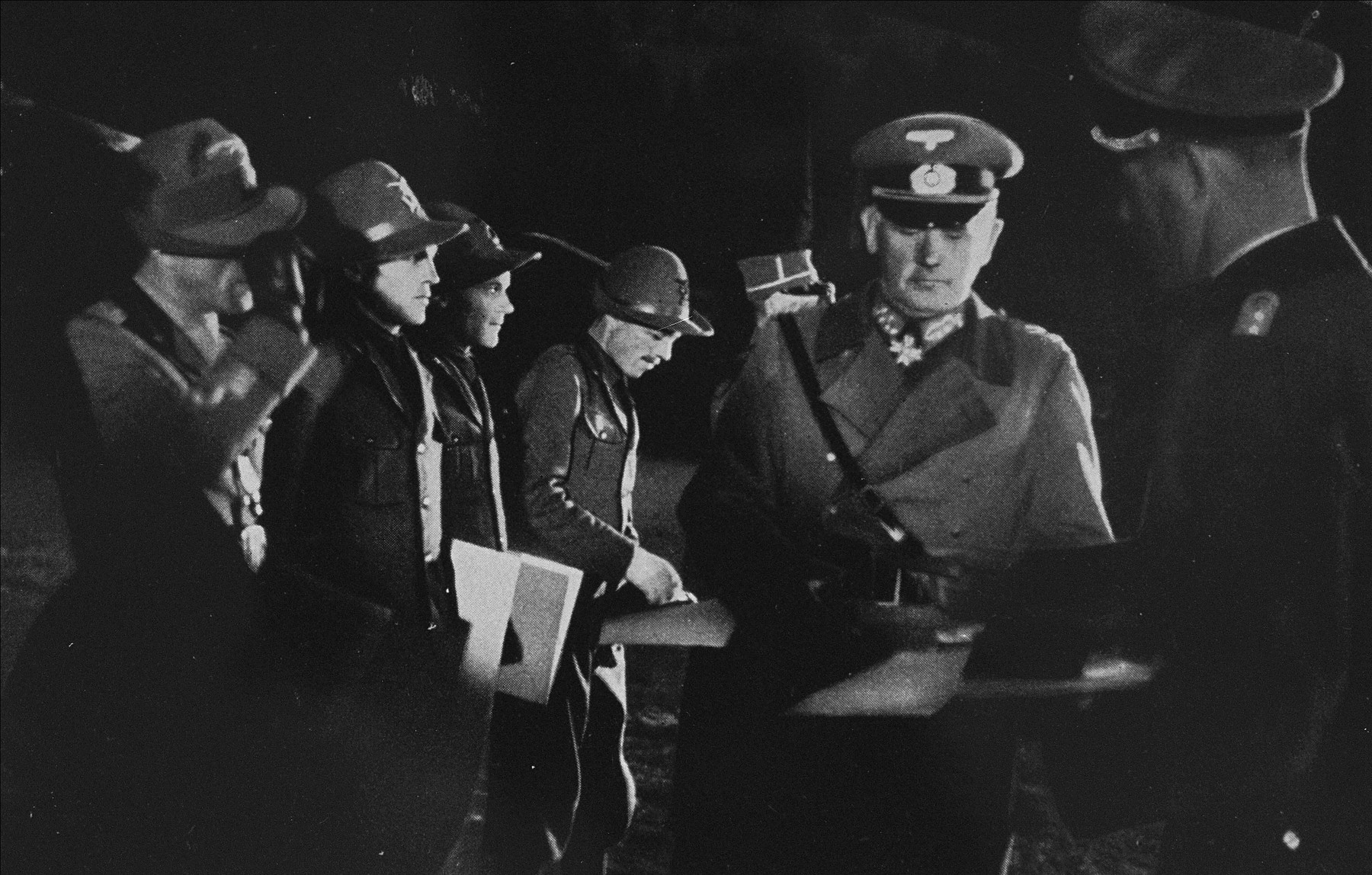 General Werner von Blomberg distributes winners' certificates to an Italian military patrol.    These certificates were awarded to competitors who participated in exhibition sports during the 1936 Winter Olympics.