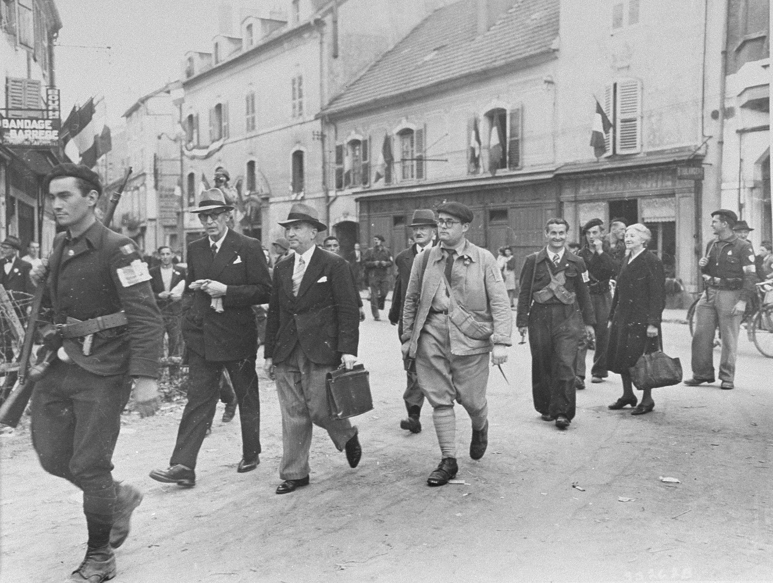 Members of the Free French Forces of the Interior (FFI, Forces Francaises de l'Interieur) lead the Judge and Mayor of Vesoul to prison for collaborating with the Germans.