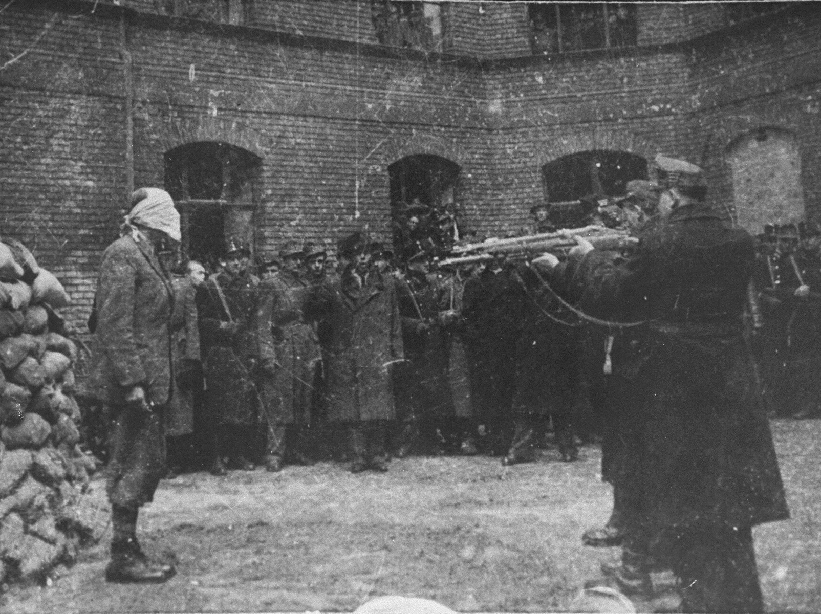 Hungarian soldiers prepare to execute Bela Imredy, the former Prime Minister in the Sztojay government.  The second trial of a former Hungarian government official to be undertaken by the People's Tribunal in Budapest, the trial of former Prime Minister Bela Imredy began on November 14, 1945 in the Budapest Academy of Music and lasted until November 23, 1945.  Imredy was charged with responsibility for enacting Hungary's anti-Jewish legislation in 1938 and 1939, as well as with cooperating with the Third Reich, crimes for which he was found convicted and executed on February 28, 1946.
