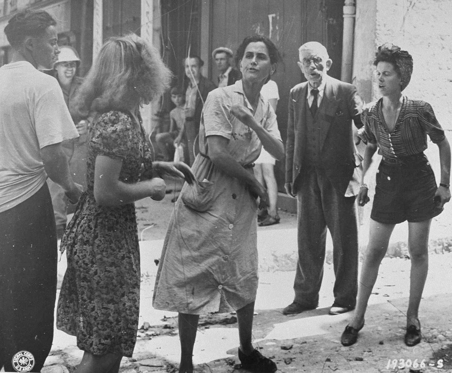 In the streets of Brignoles, angry French citizens publicly rebuke a woman who is suspected of having collaborated with the Germans.