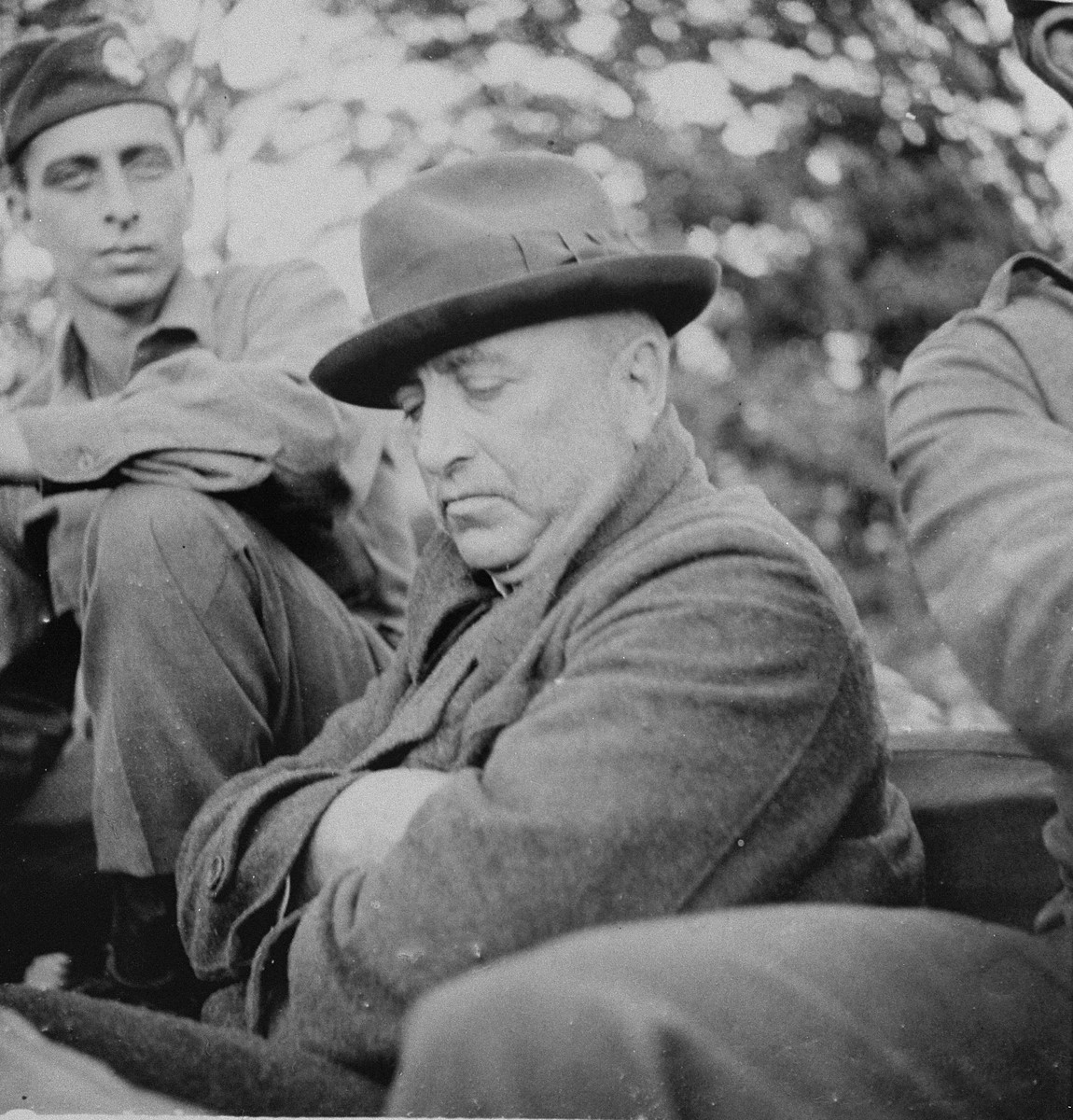 Dr. Robert Ley, the former leader of the German Labor Front (DAF), following his arrest by American troops with the 101st U.S. Airborne Division at his mountain home near the Austrian border.  The American soldier pictured is  Robert Guggenheim.   At the time of his capture, Ley was posing as Dr. Ernst Distelmeyer, but he was identified by Franz Xaver Schwarz, the former treasurer of the Nazi Party and one of Ley's oldest enemies.