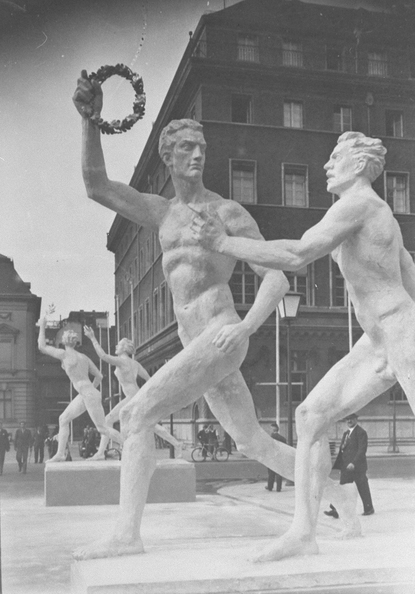 Statues of idealized male and female athletes on the street in celebration of the Olympic Games.