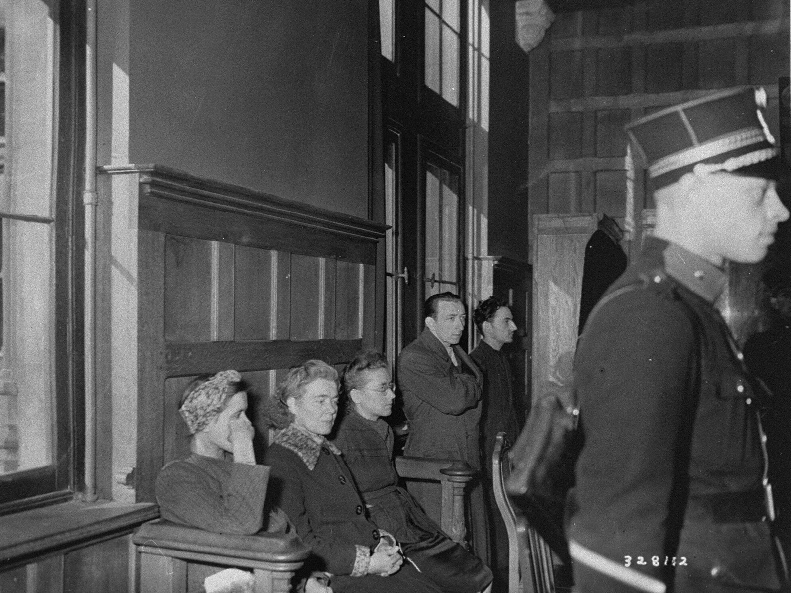 Belgian women accused of  collaborating with the Germans wait in the Liege Palace of Justice for a court to decide their fate.