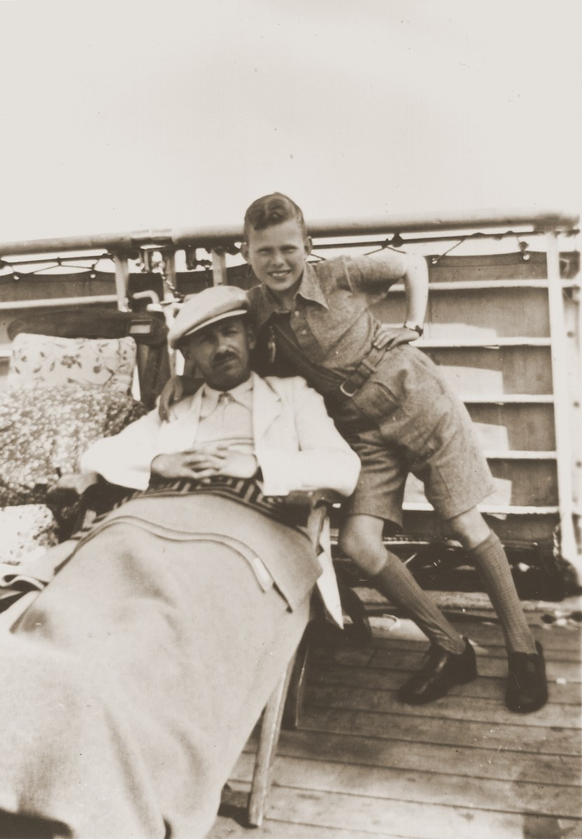 Herbert Karliner poses with his father, Joseph, on the deck of the MS St. Louis.