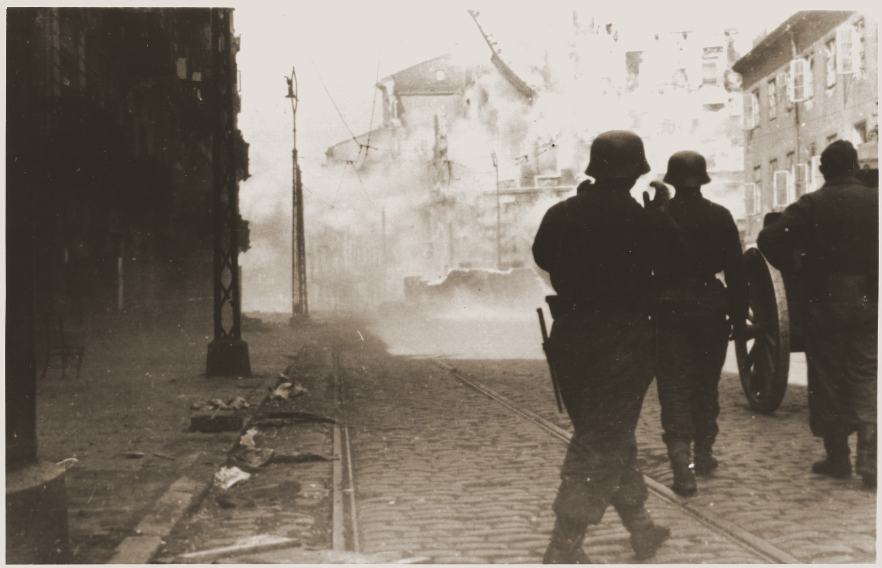 A German gun crew shells a housing block during the suppression of the Warsaw ghetto uprising.