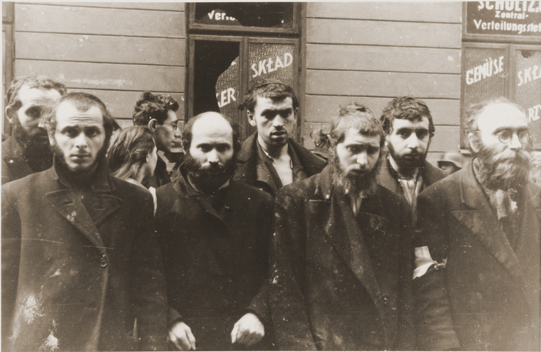 "Religious Jews captured by the SS during the Warsaw ghetto uprising.  The original German caption reads: ""Jewish rabbis.""  From left to right are Rabbi Lipa Kaplan, Eliyahu Levin (son of Rabbi Hersh Henoch of Bedzin), Mendel Alter (son of Rabbi Nechemya Alter); Yankel Levin (son of Rabbi Mottel Levin of Lodz and grandson of the rabbi of Bedzin), unknown and Rabbi Heschel Rappaport, a Gerer Chassid and mentor to young Chassidim."
