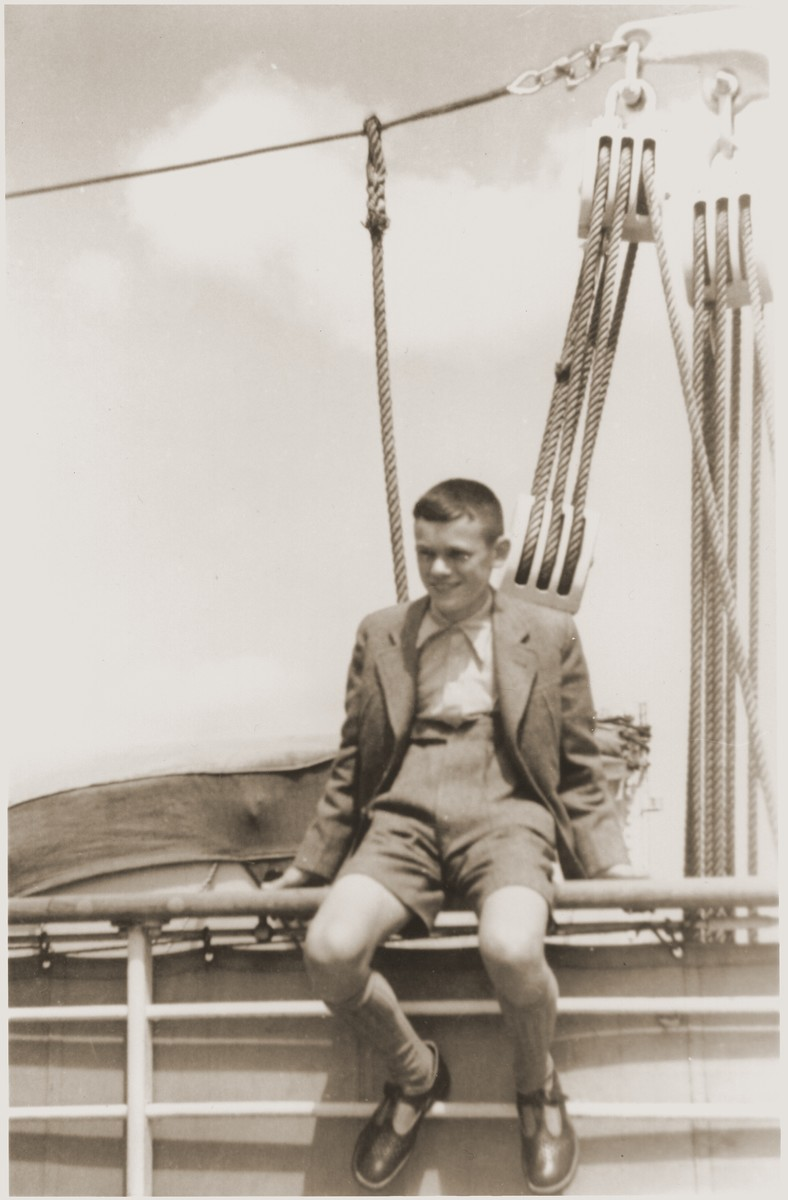 Walter Karliner sits on the railing of the MS St. Louis before its departure from Hamburg.