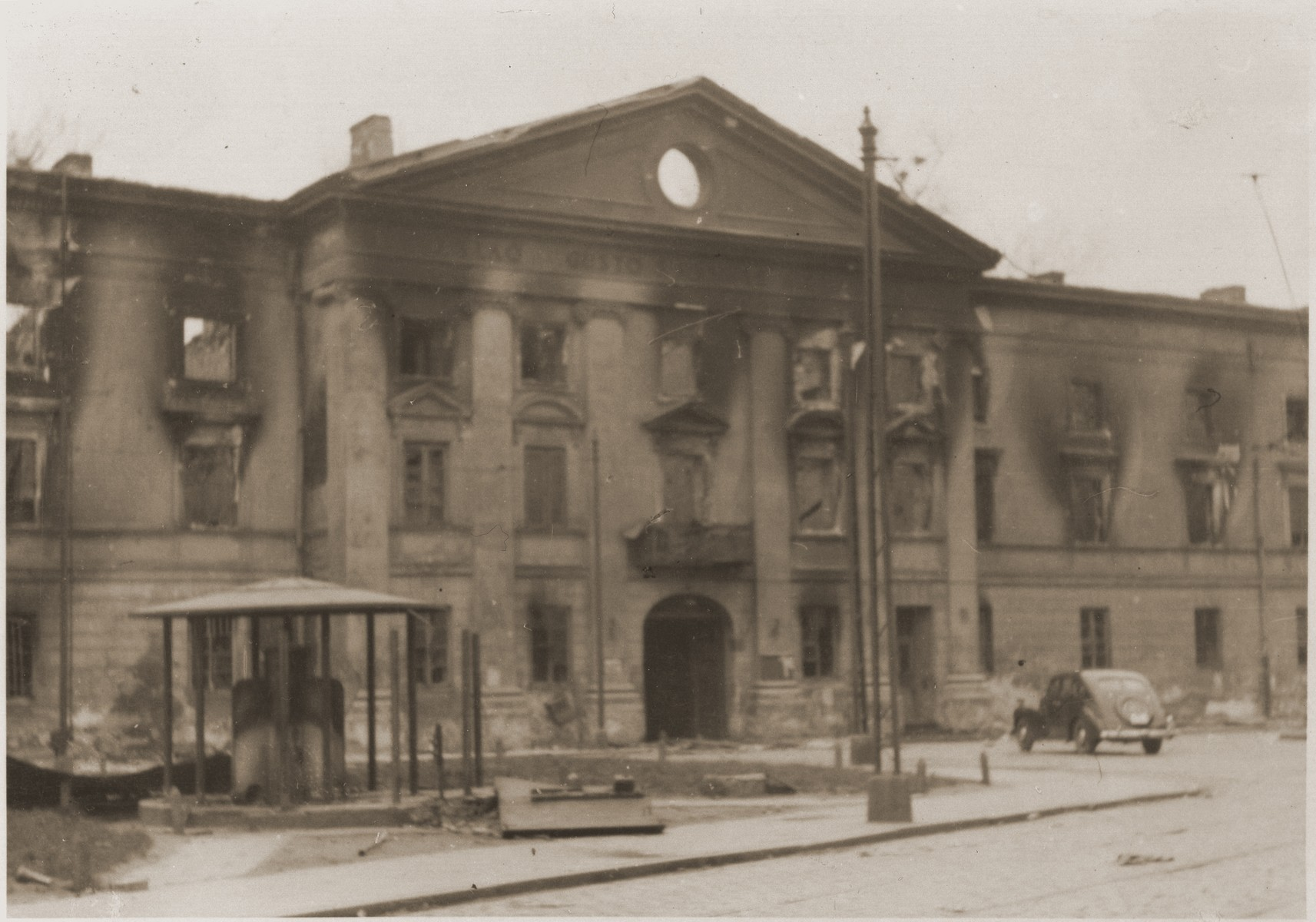 """The ruins of the former Warsaw ghetto Jewish Council building after its destruction by the SS during the ghetto uprising.  The original German caption reads """"The building of the former Jewish Council."""""""