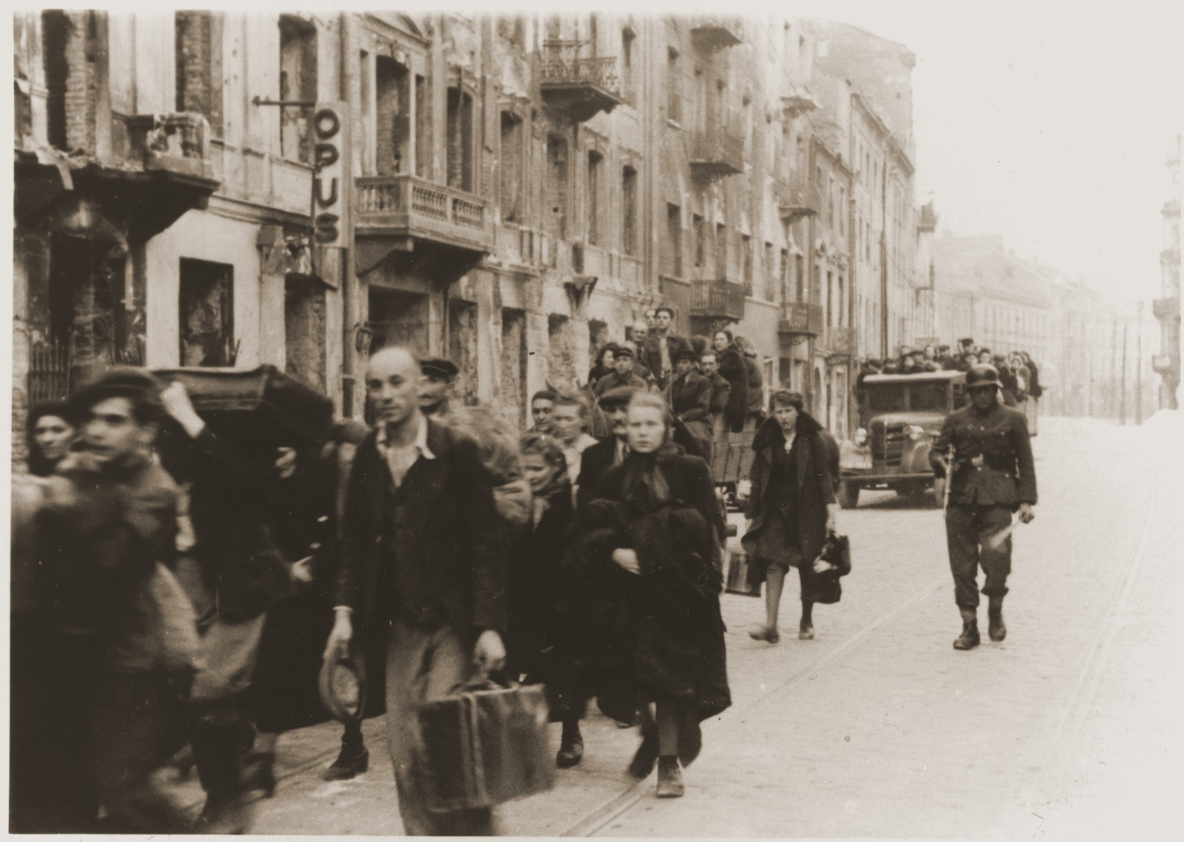 Jews captured by the SS during the suppression of the Warsaw ghetto uprising march to the Umschlagplatz for deportation.