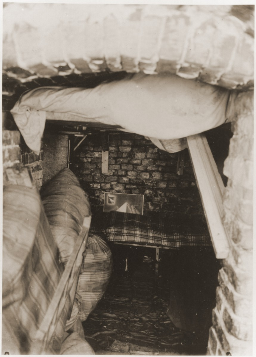 "Sleeping quarters in a bunker prepared by the Jewish resistance for the Warsaw ghetto uprising.  The original German caption reads: ""Pictures of a so-called residential bunker."""