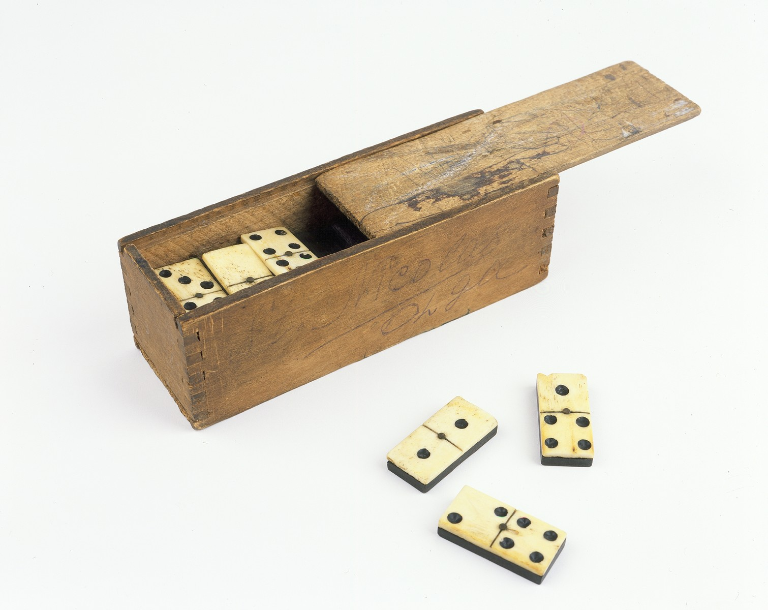 A wooden box of dominoes given to Olga Kirschenbaum as a St. Nicholas Day gift while she was in hiding.