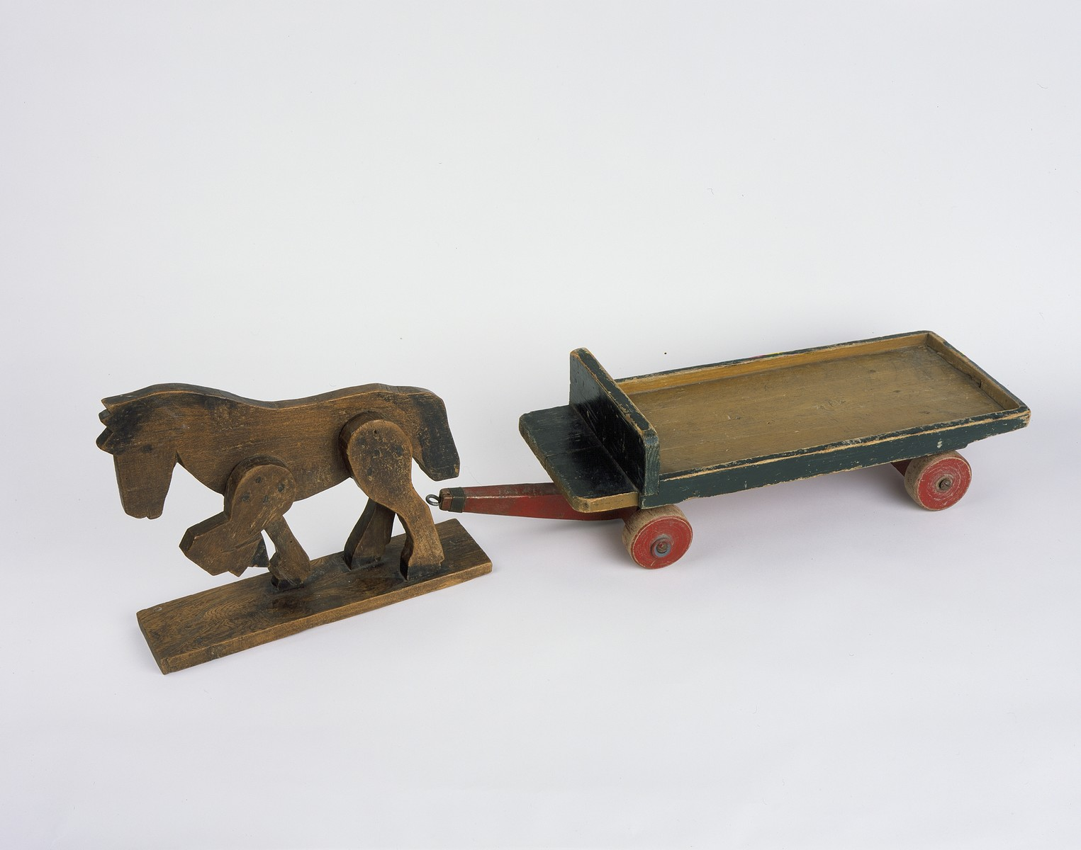 A toy wooden horse and cart used by Max Arpels Lezer, a Jewish child living in hiding in German-occupied Holland.