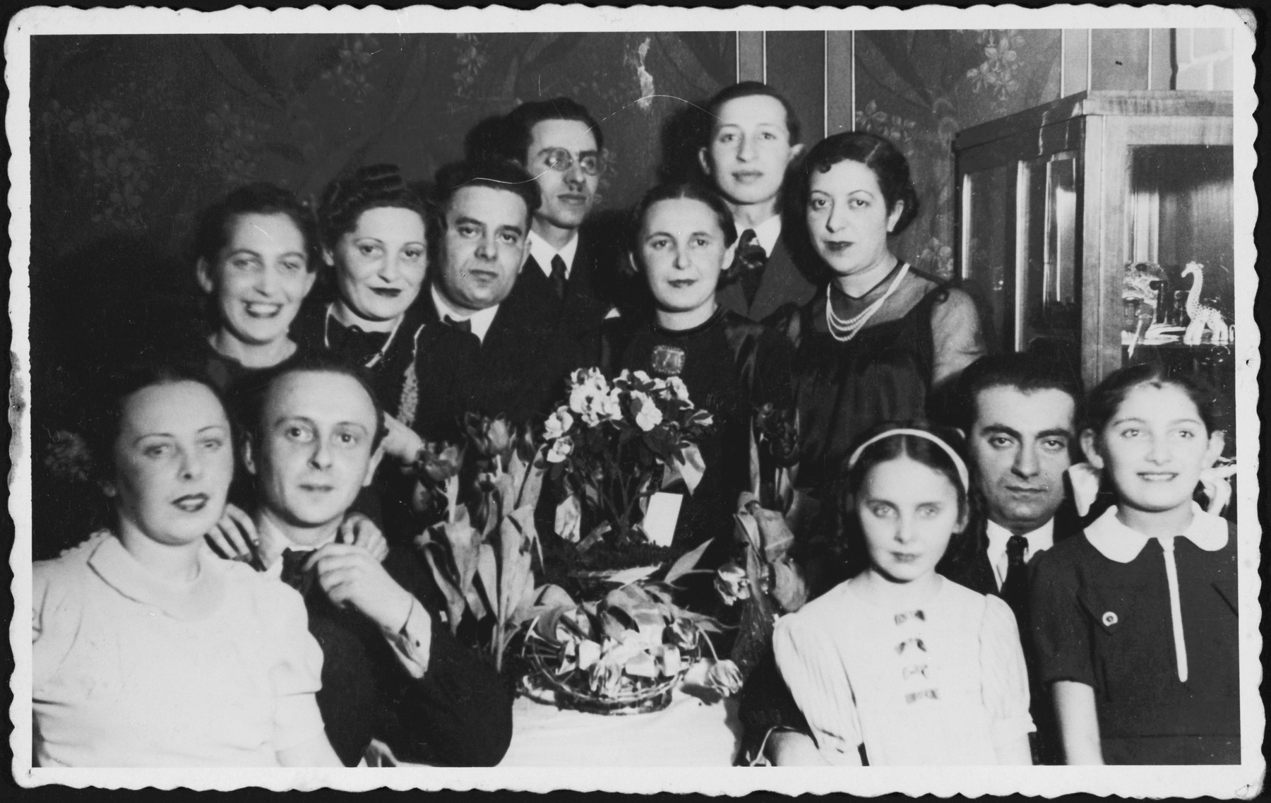 Group portrait of guests at Josef and Ada Altbeker's 10th anniversary party.