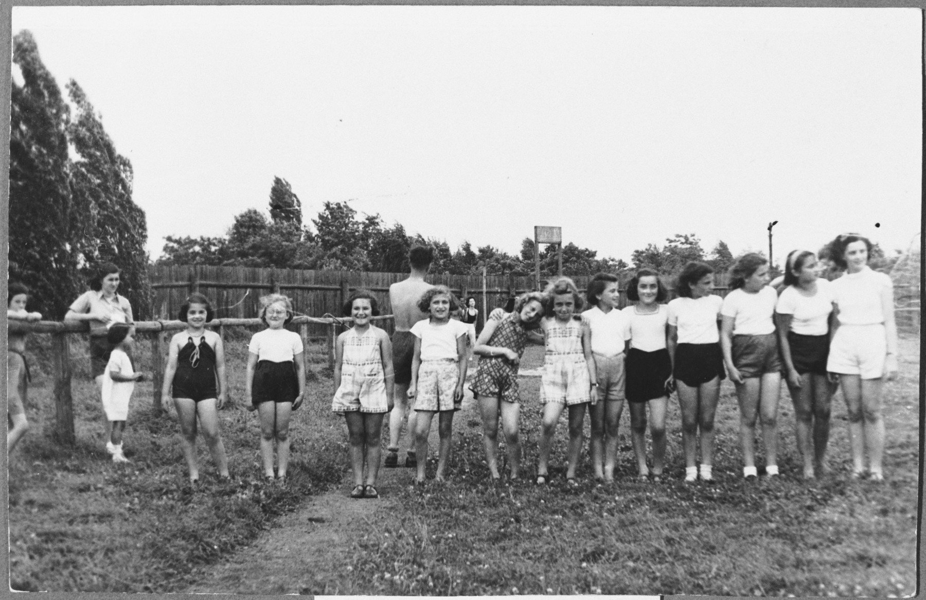 Youngs girls of a Maccabi youth pose on a field.   Among those pictured is the donor Maud Michal Stecklmacher (now Beer).
