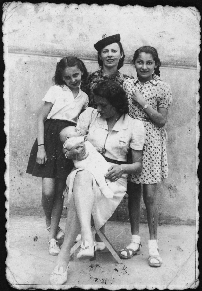 Rina Altbeker poses with her aunt, Ruth Cyprys, and other friends and family at Ruth's summer villa at or near the start of the war.