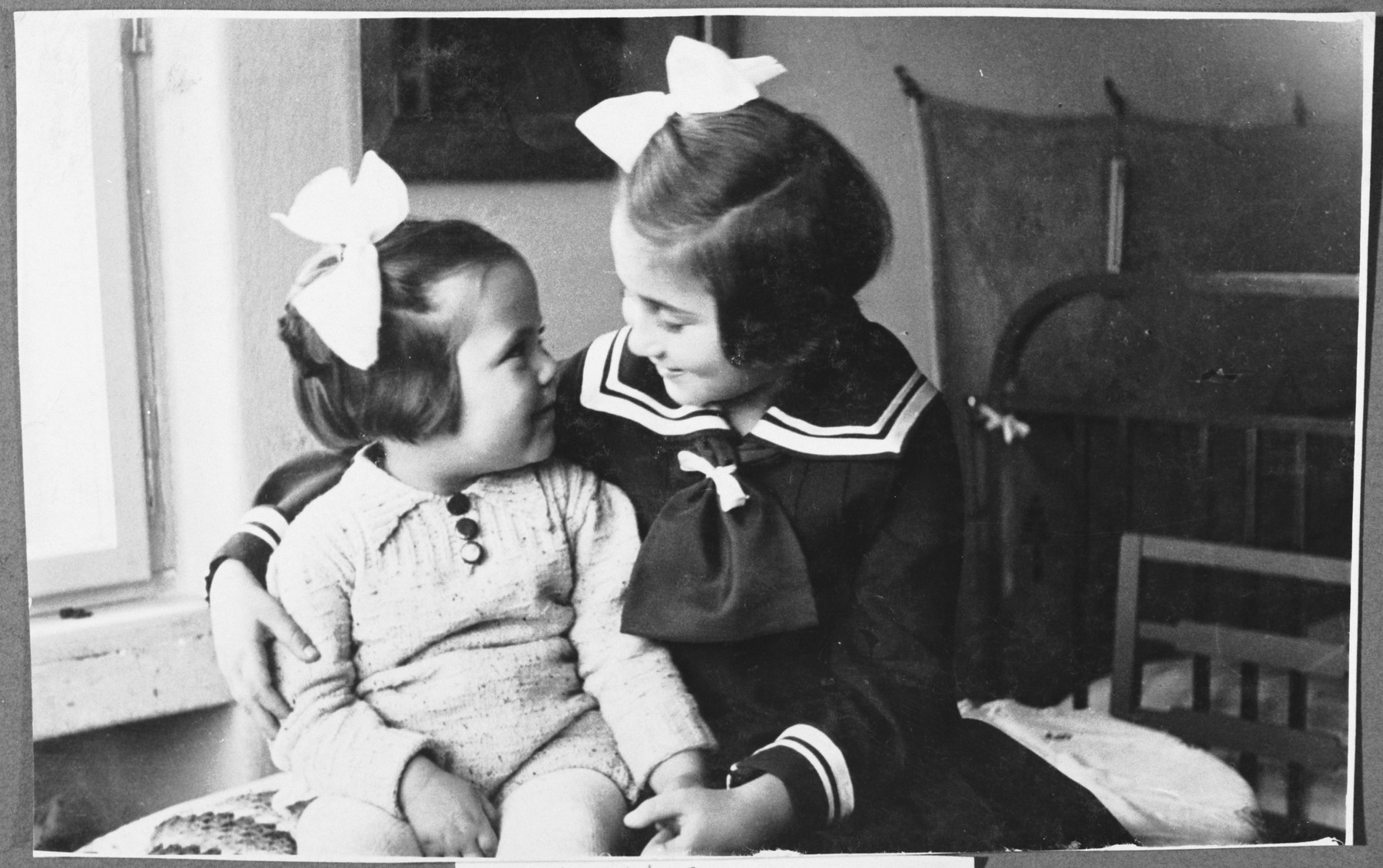Two sisters pose for a photograph in the family's nursery.   Pictured is the donor with her younger sister Karmella (Karmi).