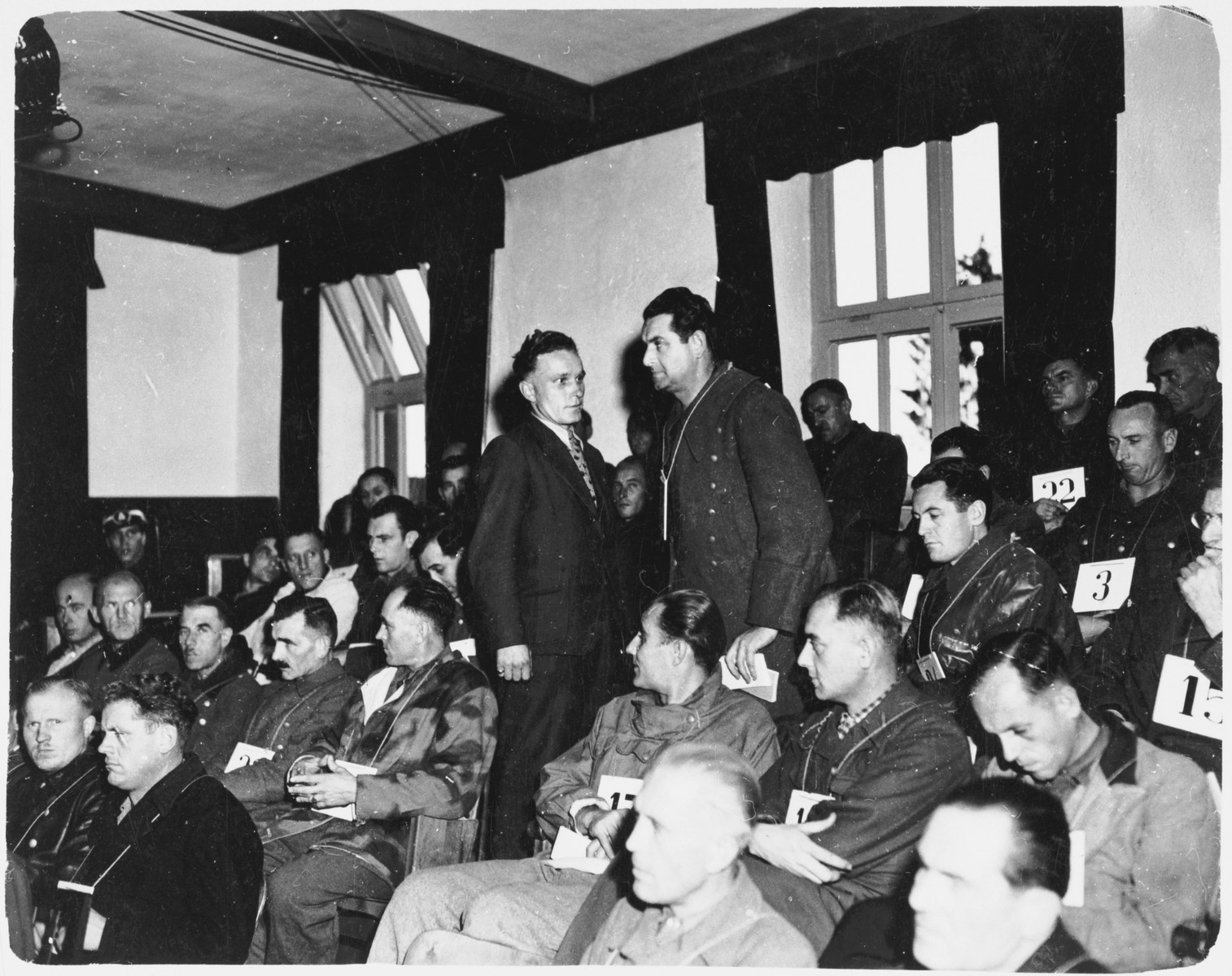 Dr. Franz Blaha, a former camp inmate, confronts Dachau commandant Martin Gottfried Weiss in the prisoner's dock.  Weiss was in charge when Blaha was forced to perform autopsies on victims of camp doctors.