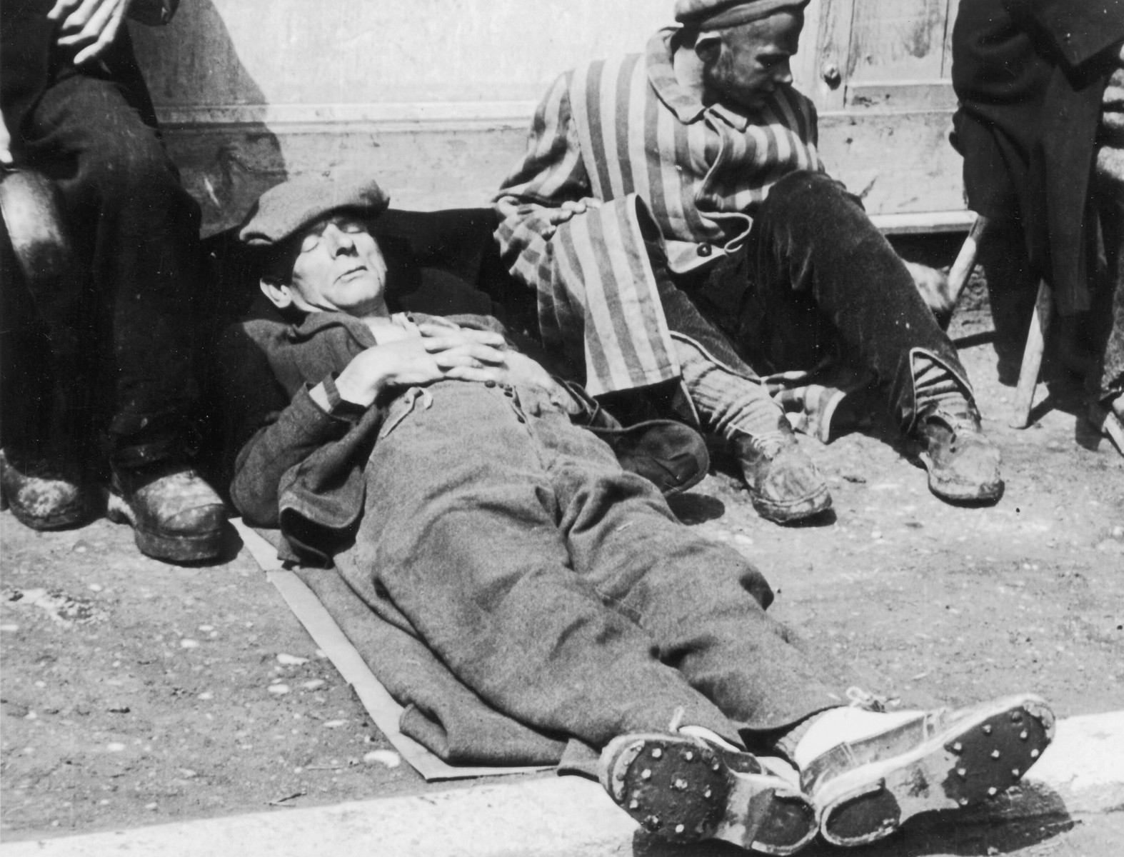 Close-up portrait of a survivor taking a nap in the Dachau concentration camp.