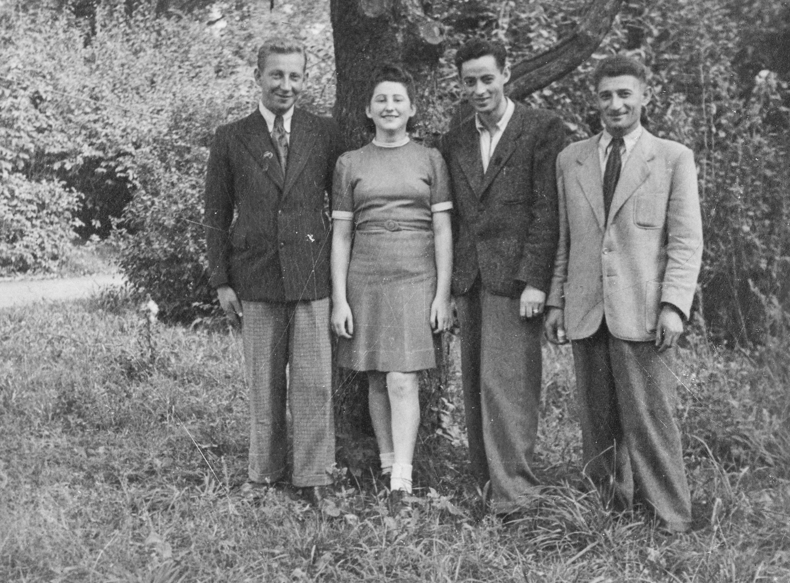 Portrait of four Jewish displaced persons in a garden in Warsaw.    Among those pictured are Rywa Gordon and her husband Izak Wertman (center).