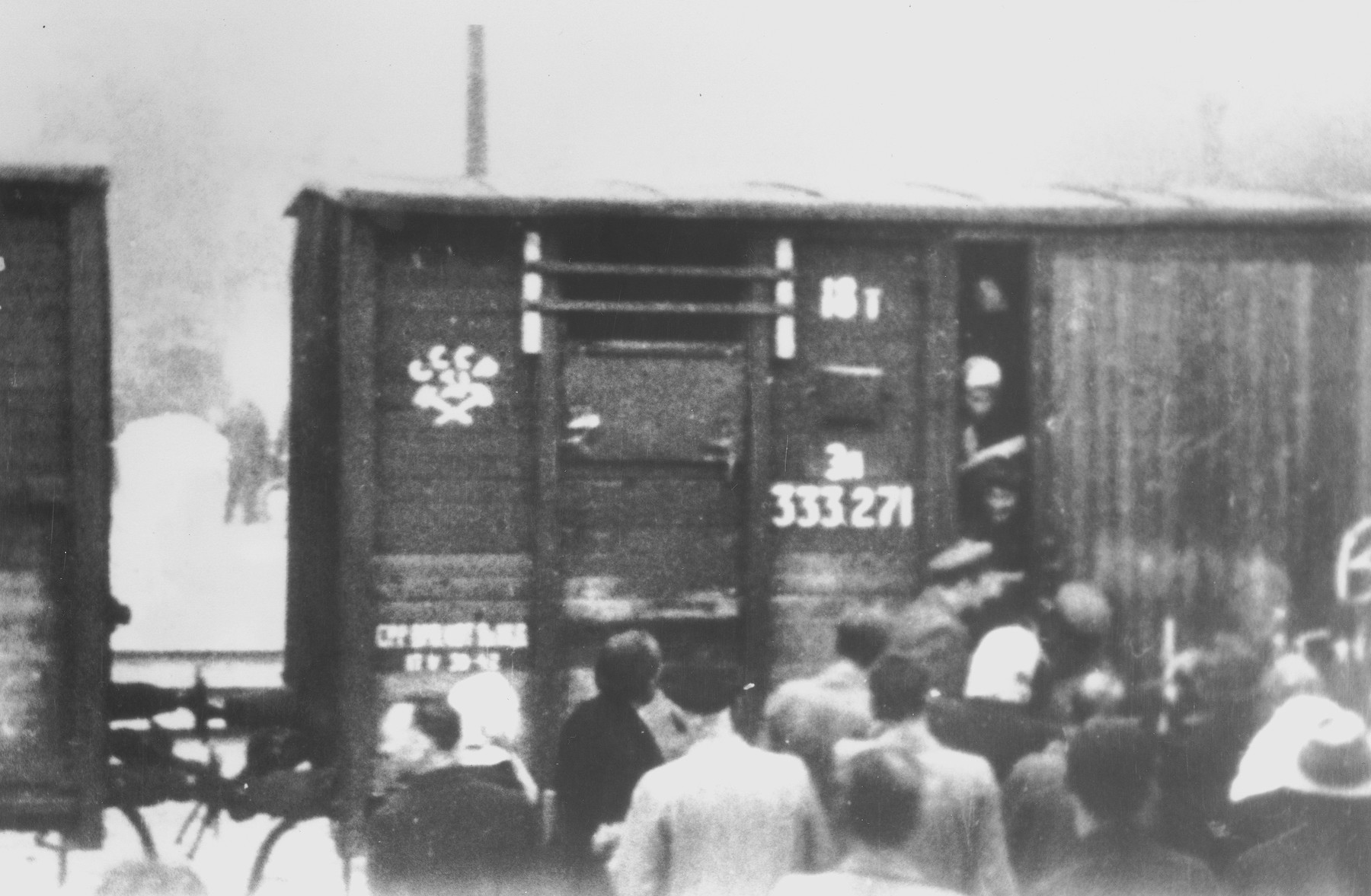 Refugees board a deportation train for labor camps in Siberia.