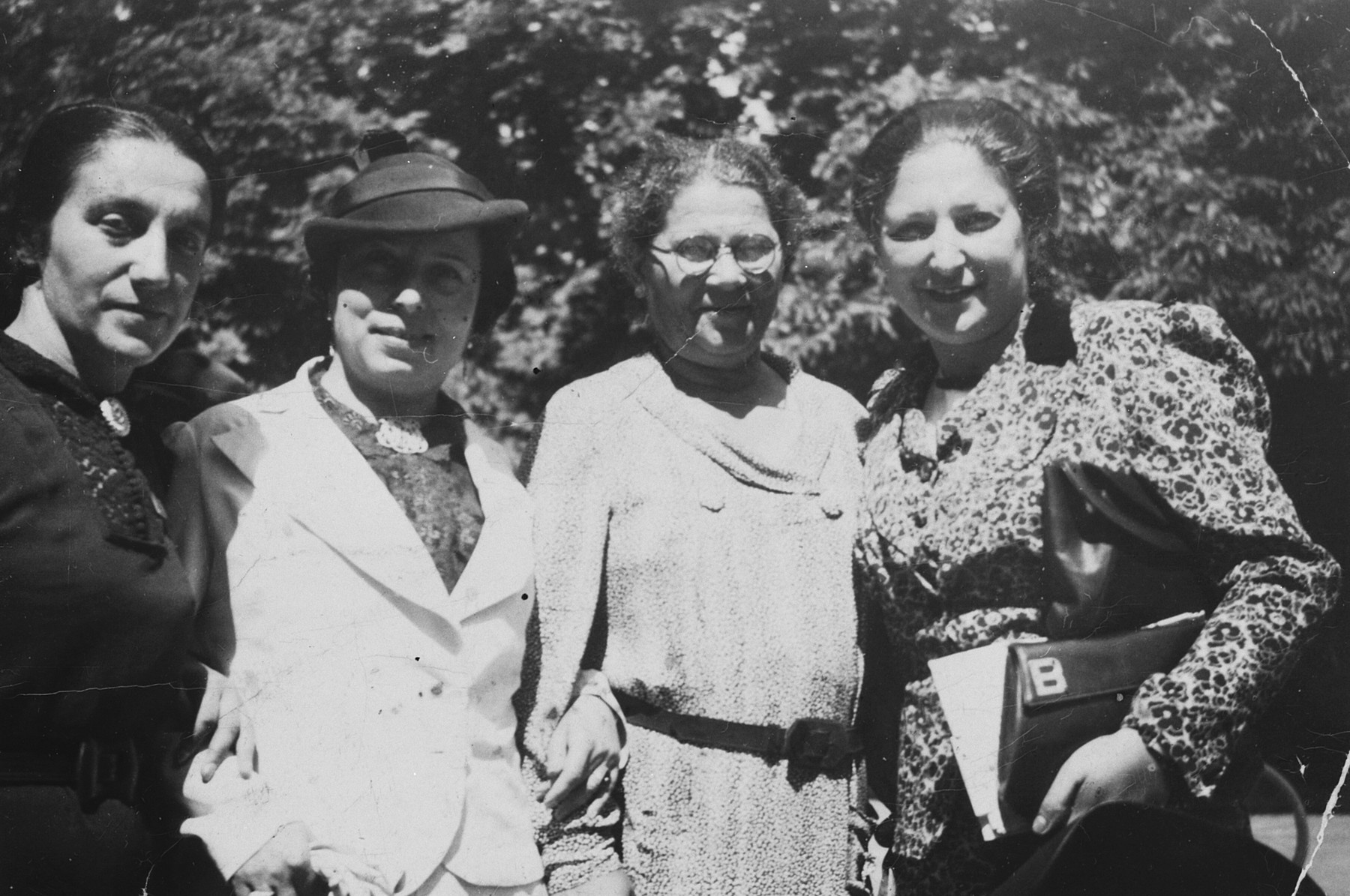 Portrait of four Slovak Jewish women.  Beatte Hartvig is on the far left.  Next to her is Gisi Fleischmann.