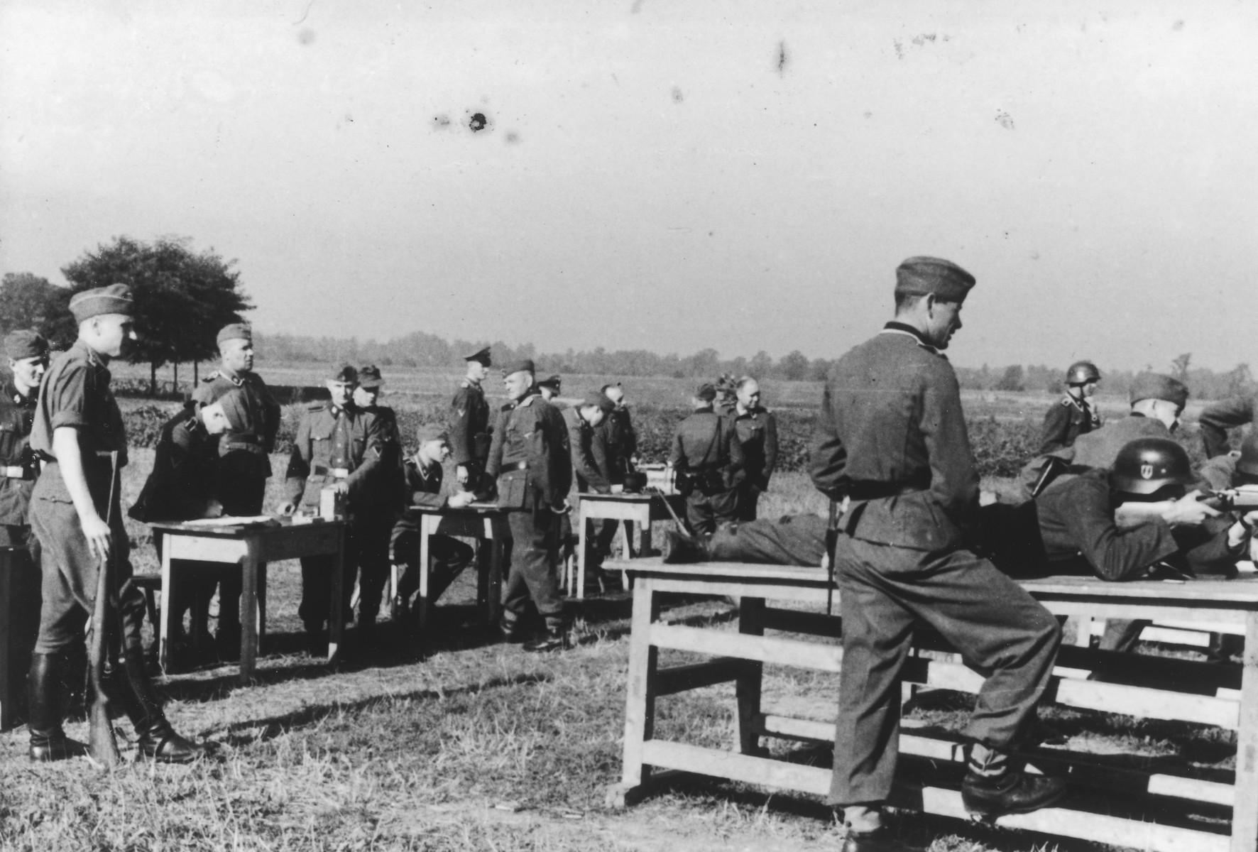 "German troops gather for target practice.  Karl Hoecker is on the far left.  The original caption reads ""Der Schuss wurde eine 12"" (the shot was a 12)."