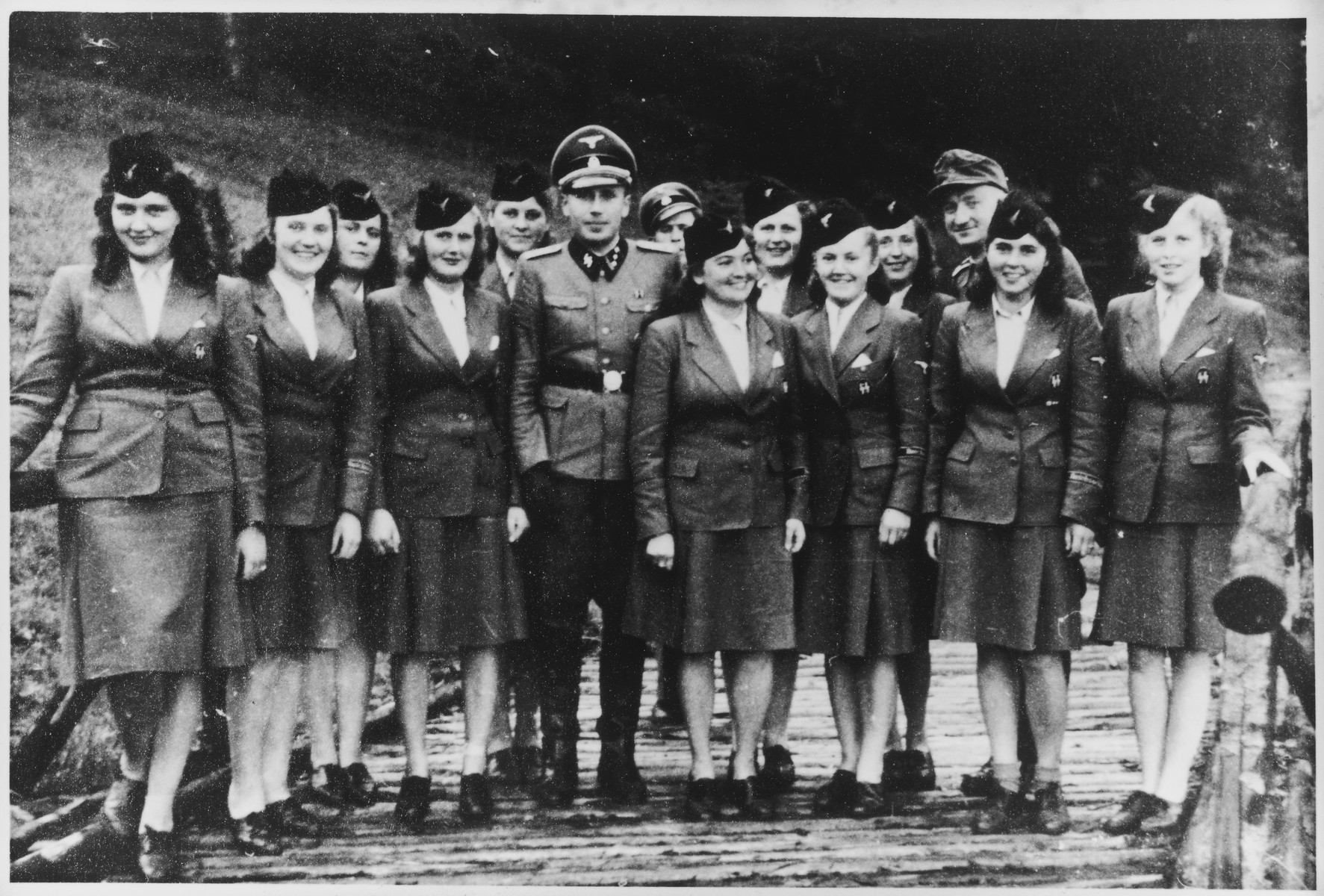 "Members of the SS Helferinnen (female auxiliaries) arrive in Solahuette, the SS retreat near Auschwitz.   Karl Hoecker is standing in the center.  The original caption reads ""Mit den SS Maiden auf der Solahuette 22.7.44"" [with the SS maiden in Solahuette 22.7.44]."