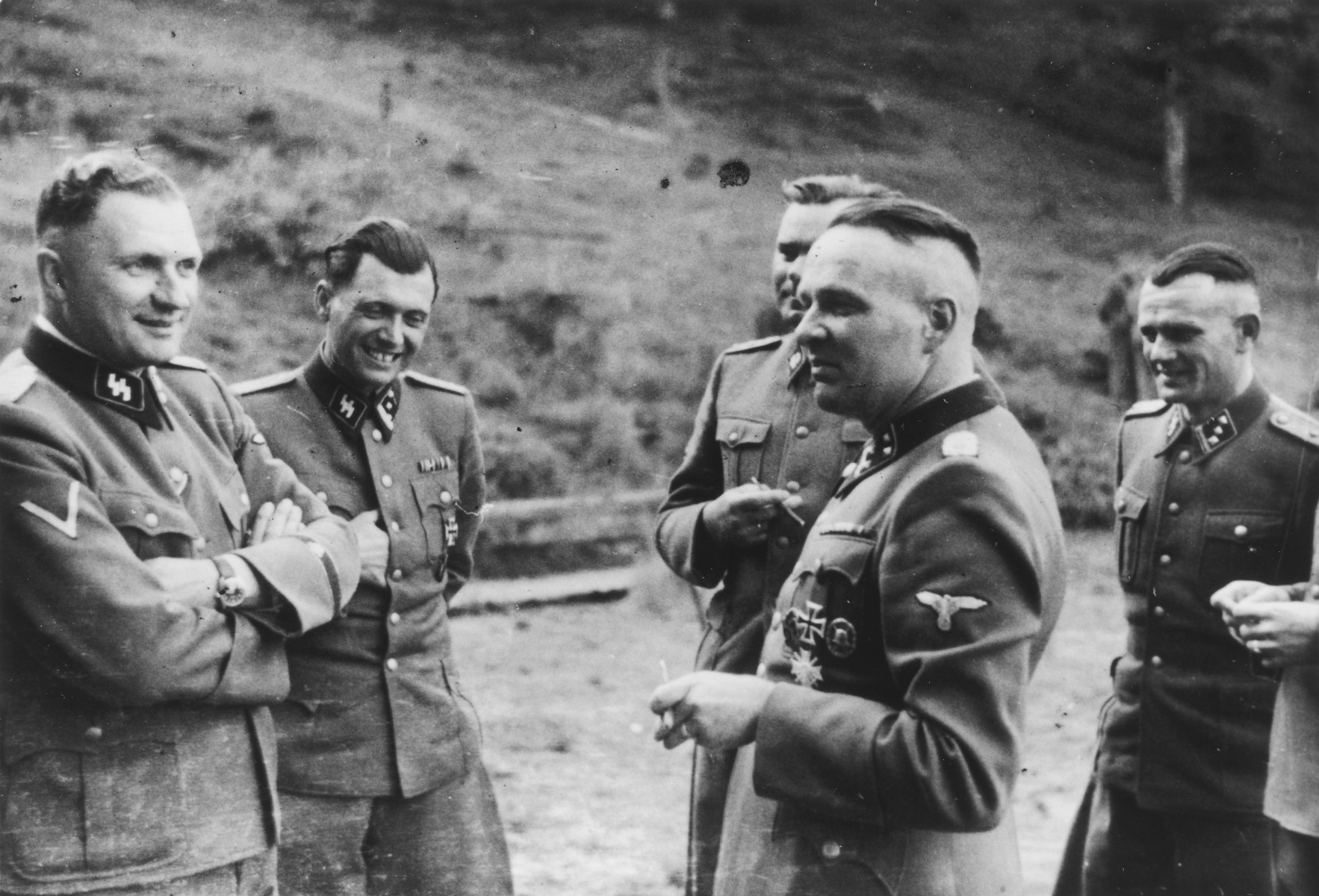 SS officers socialize at their retreat at Solahuette outside of Auschwitz.  From left to right are Richard Baer, Josef Mengele, Josef Kramer, Rudolf Hoess and Anton Thumann.  [Based on the officers visiting Solahutte, we surmise that the photographs were taken to honor Rudolf Hoess who completed his tenure as garrison senior on July 29.]