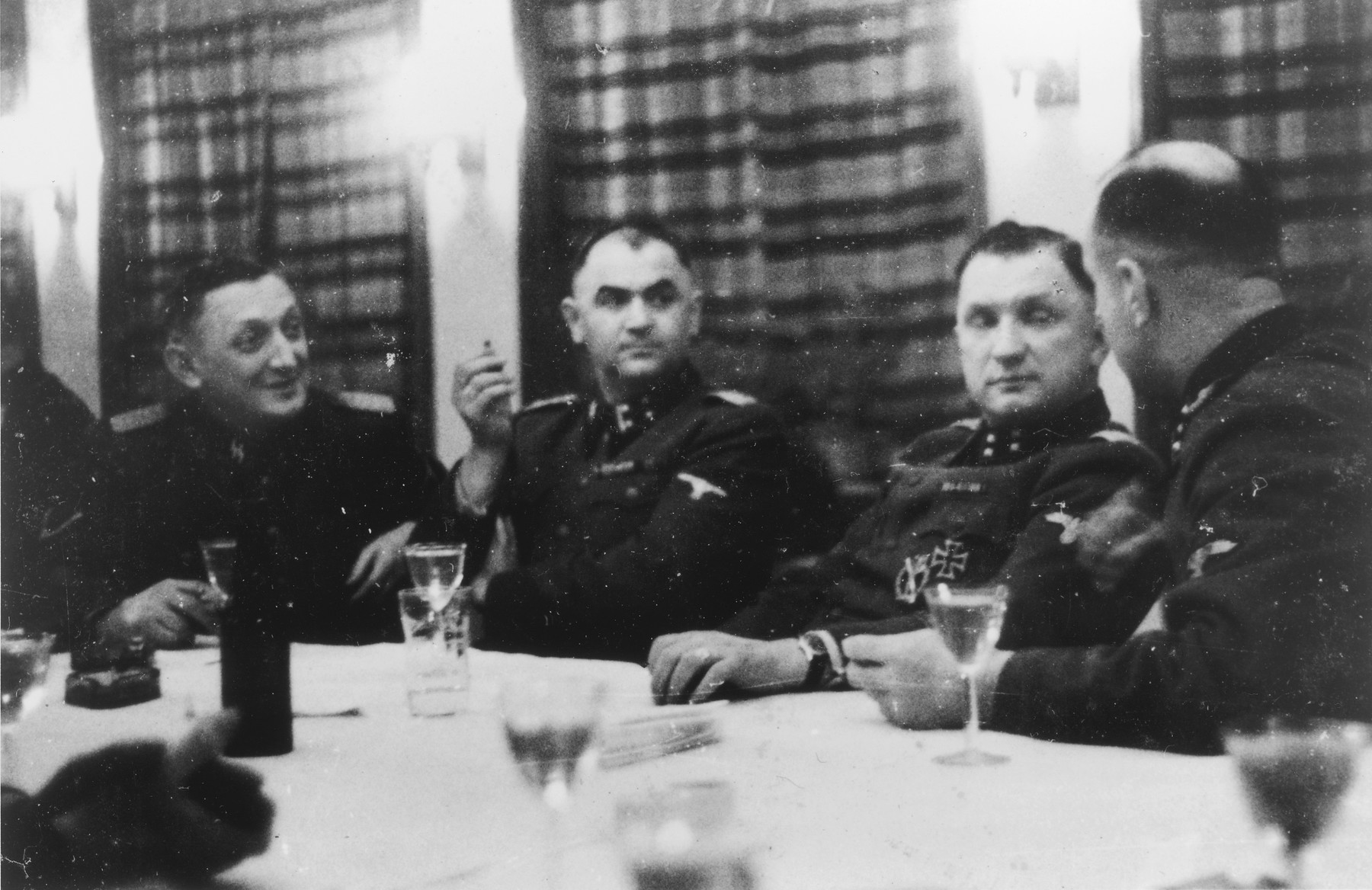 Four SS officers gather for drinks in a hunting lodge.  From left to right are Franz Xaver Kraus, Karl Moeckel and Richard Baer. Franz Xaver Kraus was brought to Auschwitz in December 1944 to facilitate the evacuation of the camp.