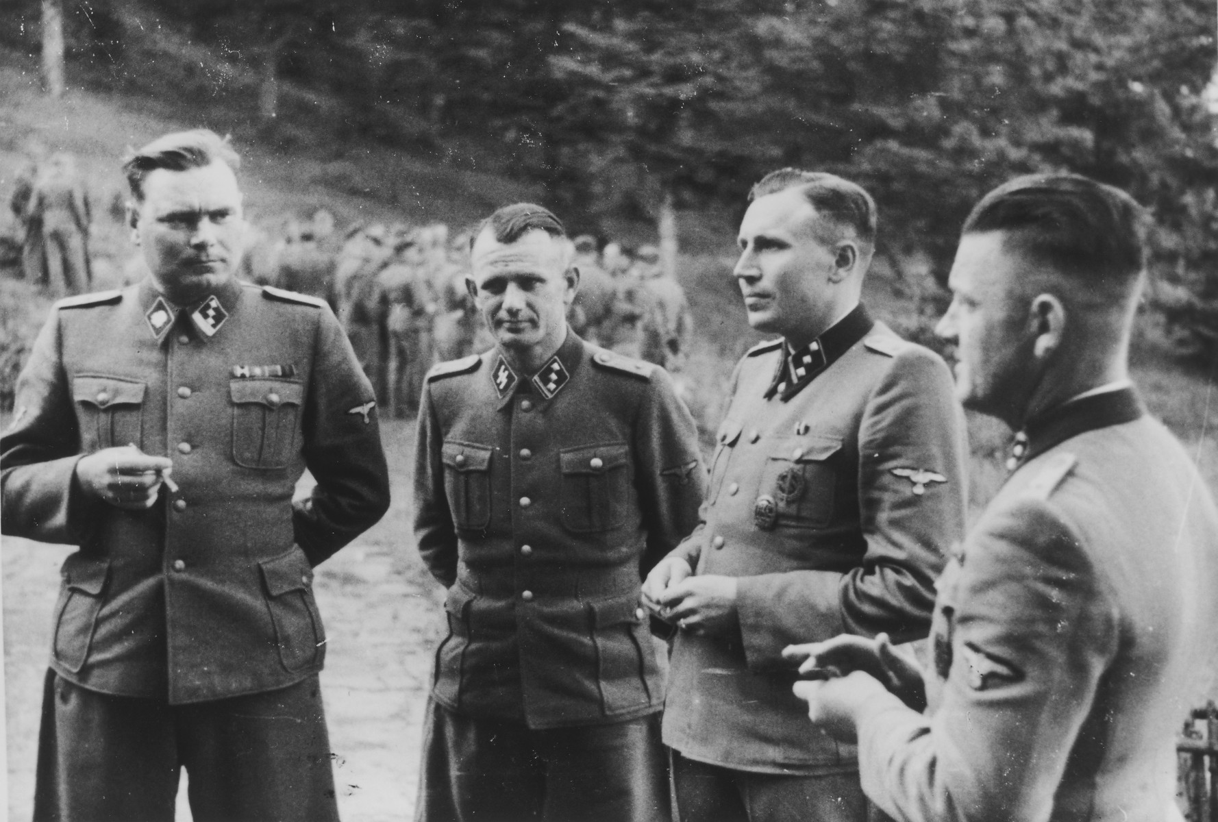 SS officers socialize on the grounds of the SS retreat Solahuette, outside of Auschwitz.  From left to right: Josef Kramer, Anton Thumann, Karl Hoecker, and Franz Hoessler.