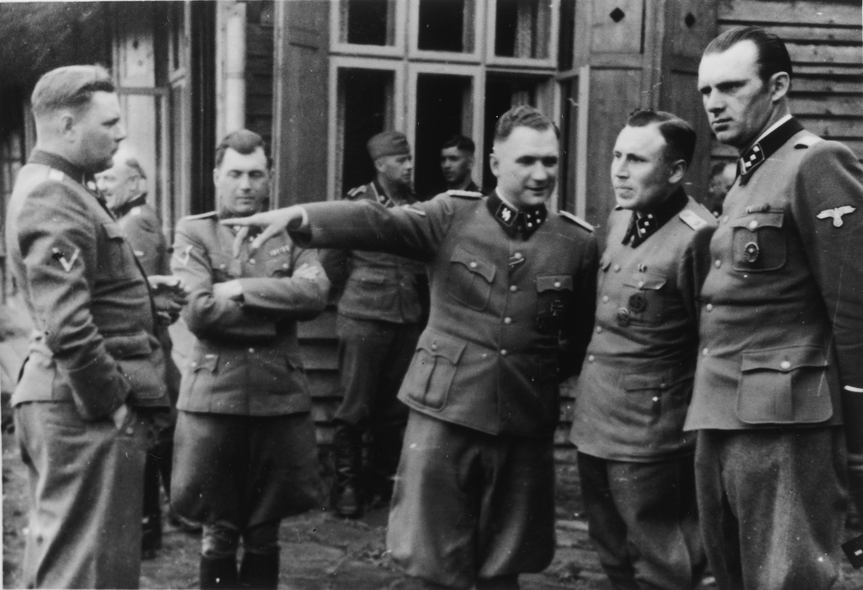 A group of SS officers gather iat Solahuette, the SS retreat outside of Auschwitz.  From left to right are Josef Kramer, Dr. Josef Mengele, Richard Baer, Karl Hoecker and Walter Schmidetzki.   [Based on the officers visiting Solahutte, we surmise that the photographs were taken to honor Rudolf Hoess who completed his tenure as garrison senior on July 29.]