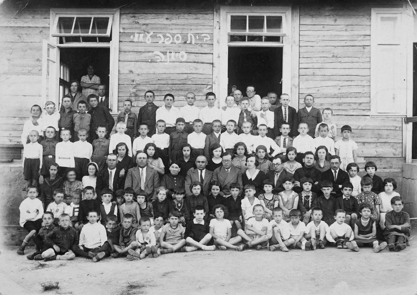 Group portrait of the students in the Hebrew school in Simnas Lithuania.  Among those pictured are the four Weinstein brothers.  Aba is standing in the top row, fifth from the right.  Benjamin is on the far right of the top row.  Joseph is in the second row, second from the left.  Yehuda is in the first row, sixth from the left.