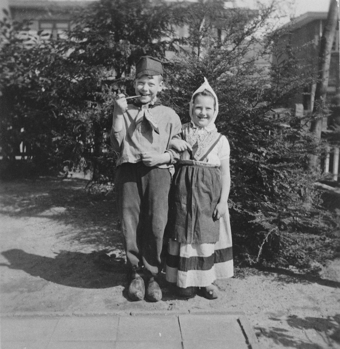 Max and Miep van Engel celebrate Purim by dressing up in traditional Dutch costumes.  The siblings had survived the war in hiding.